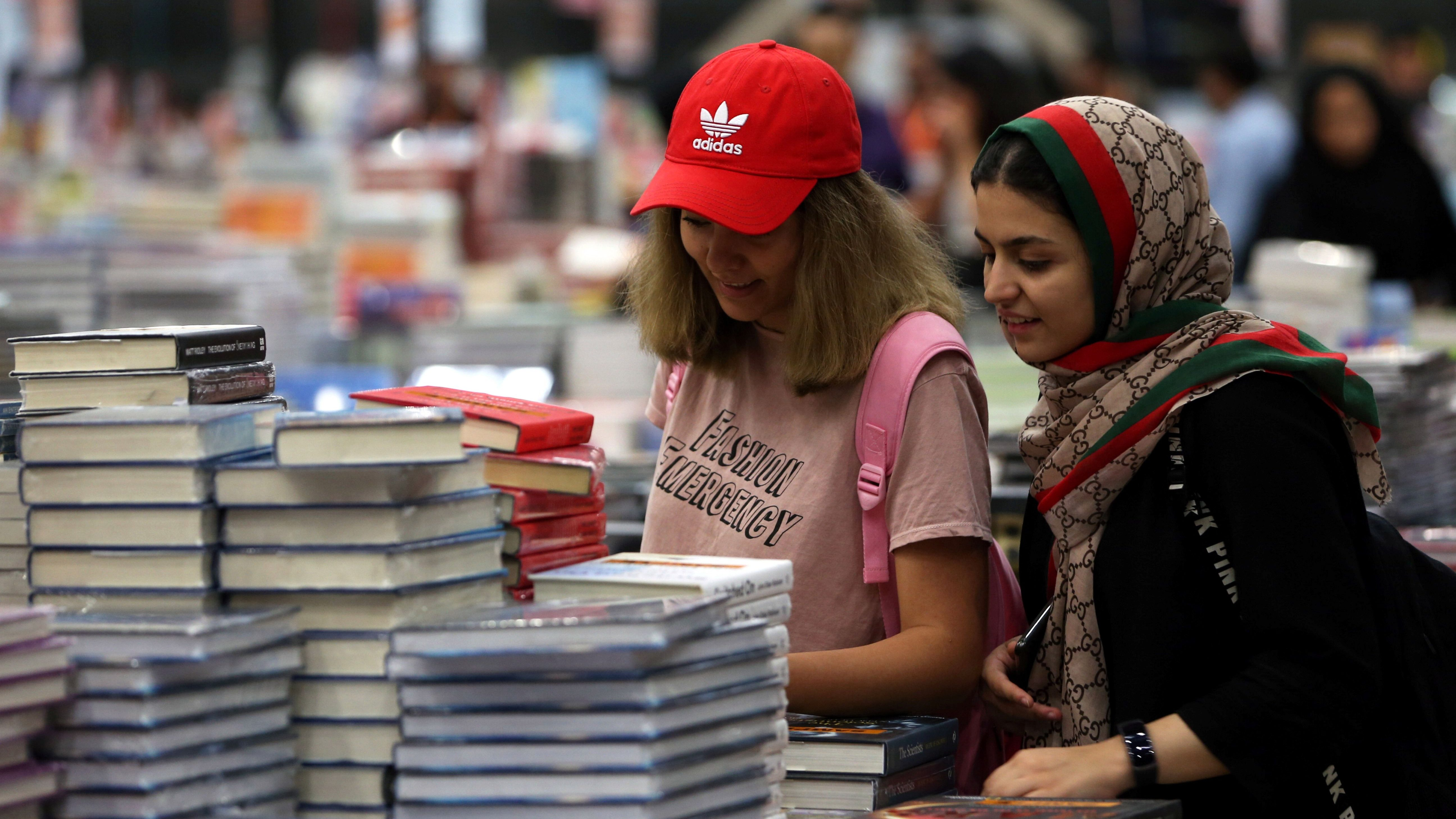Visitors read books at the Big Bad Wolf Book Sale, which calls itself the world's biggest, hosted for the first time by Dubai