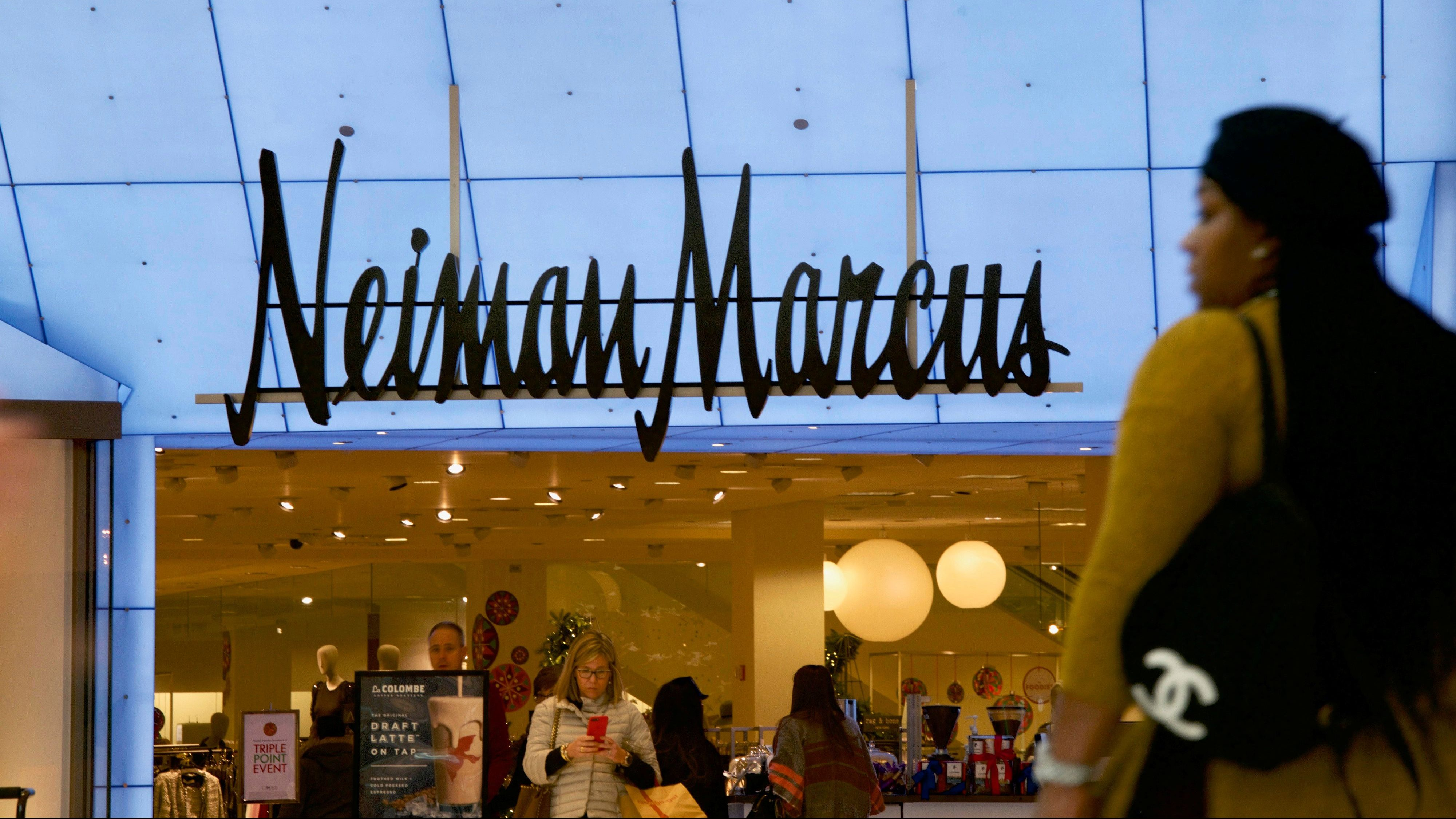 Shoppers enter and exit the Neiman Marcus at the King of Prussia Mall, United States' largest retail shopping space, in King of Prussia, Pennsylvania, U.S., December 8, 2018. REUTERS/Mark Makela - RC127A851360