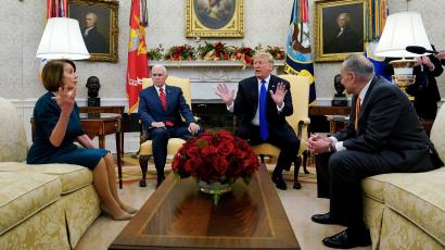 FILE PHOTO: U.S. House Speaker designate Nancy Pelosi (D-CA) speaks with Vice President Mike Pence and U.S. President Donald Trump as they meet with her and Senate Minority Leader Chuck Schumer (D-NY) in the Oval Office at the White House in Washington, U.S., December 11, 2018. REUTERS/Kevin Lamarque/File Photo - RC1FB358C9C0