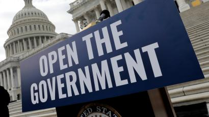 "A sign that say ""Open the Government"" in front of the Capitol building in DC."