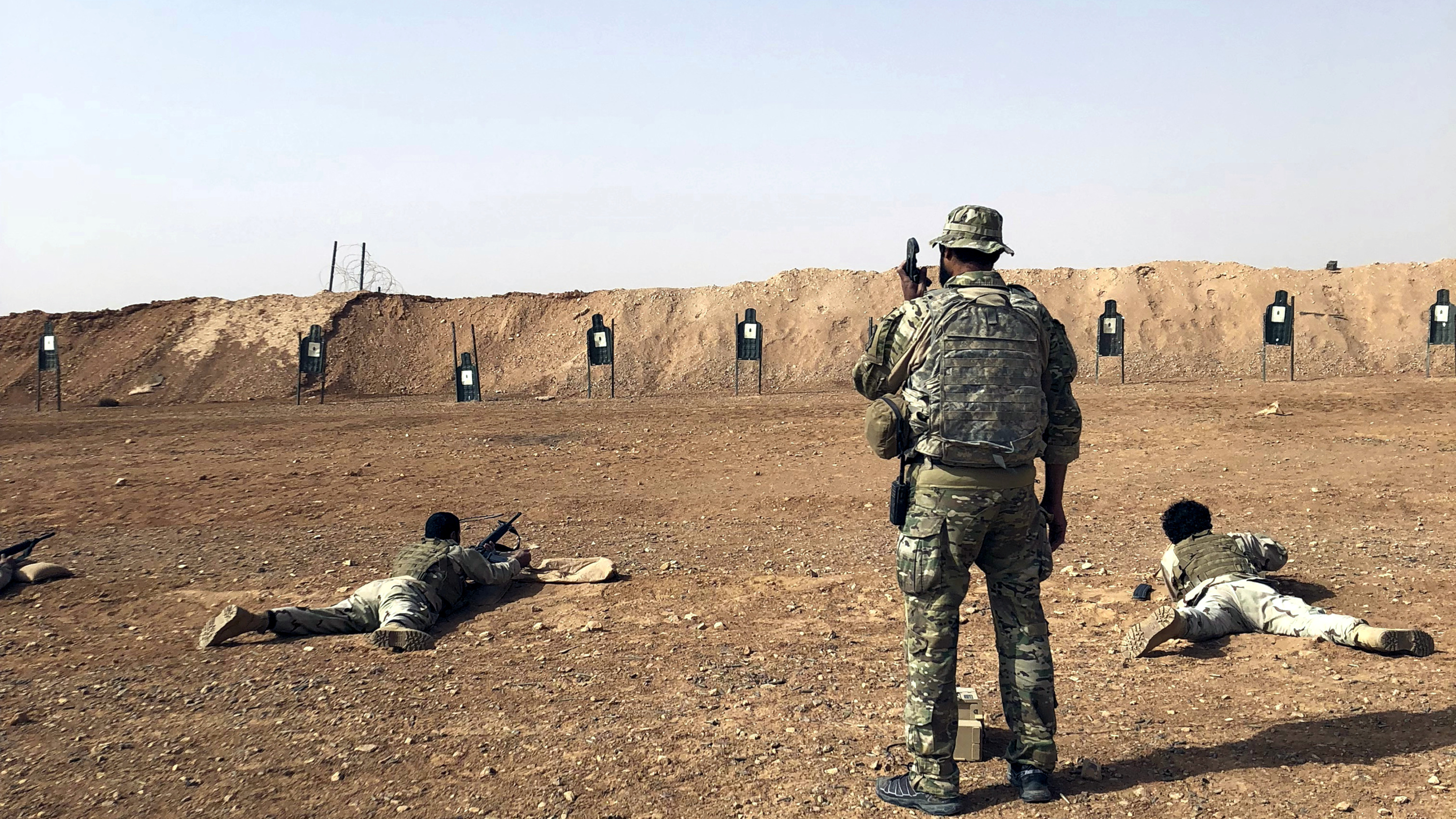 Members of the Maghawir al-Thawra Syrian opposition group receive firearms training from U.S. Army Special Forces soldiers at the al-Tanf military outpost in southern Syria on Monday, Oct. 22, 2018.