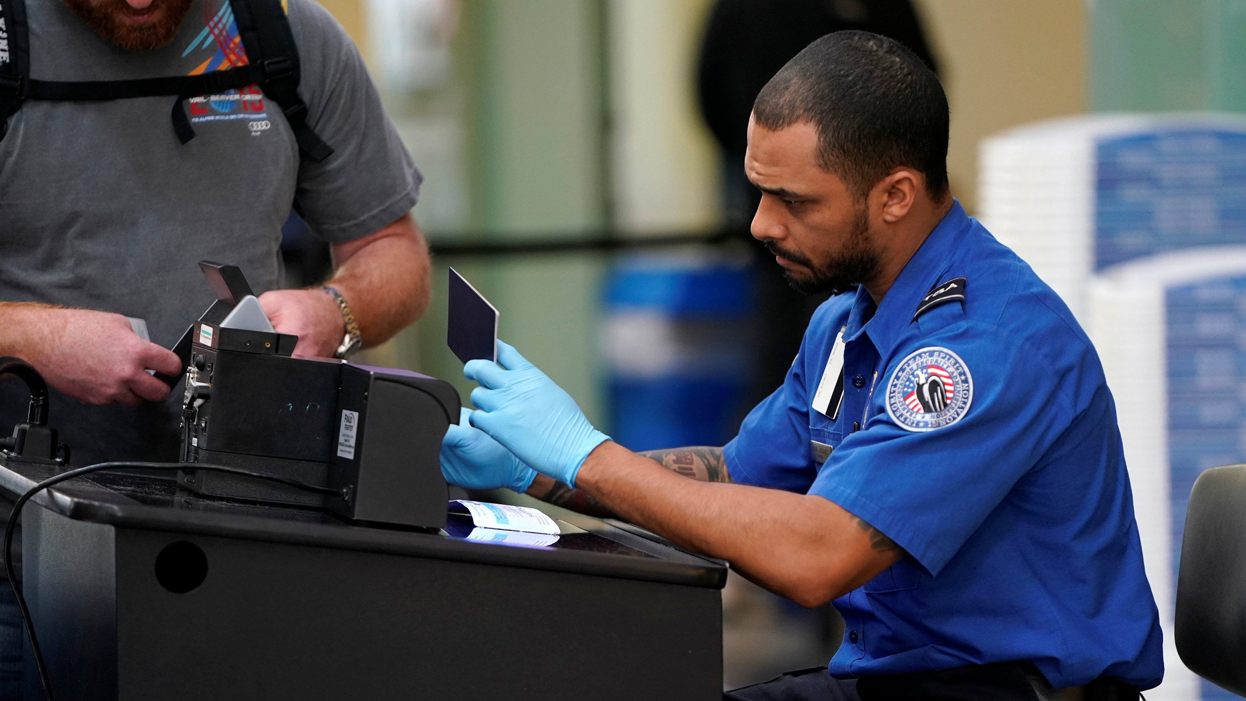 TSA agent checks document