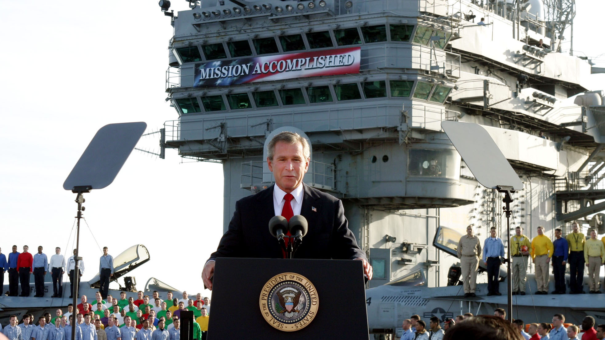 "** FILE ** President Bush declares the end of major combat in Iraq as he speaks aboard the aircraft carrier USS Abraham Lincoln off the California coast, in this May 1, 2003 file photo. Democratic congressional leaders on Tuesday, May 1, 2007 sent Iraq legislation setting timetables for U.S. troop withdrawals to President George W. Bush and a certain veto. On the fourth anniversary of the president's ""Mission Accomplished"" speech, Senate Majority Democratic Leader Harry Reid said that Bush ""has put our troops in the middle of a civil war. A change of course is needed."""