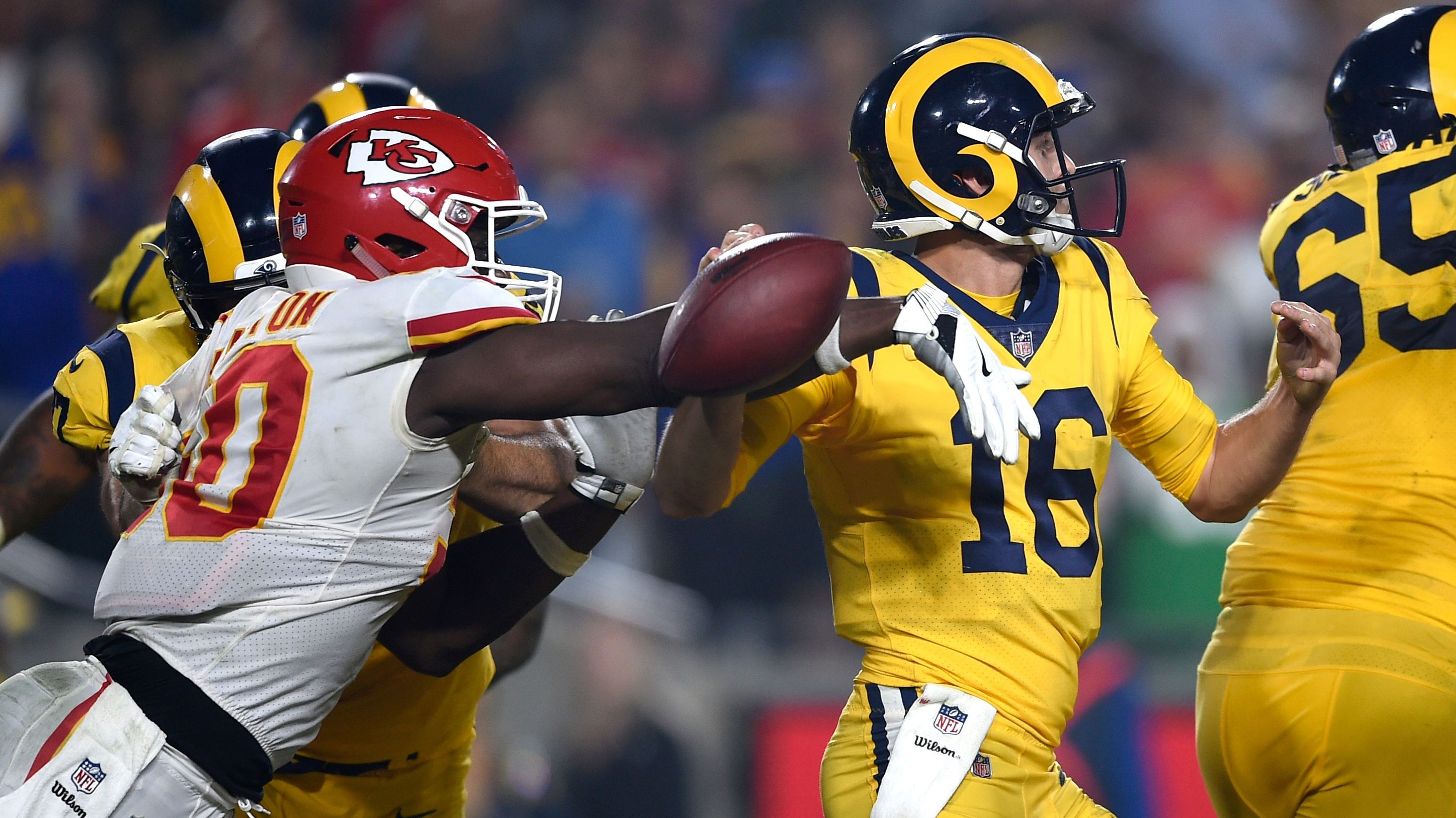 Kansas City Chiefs outside linebacker Justin Houston, left, strips the ball away from Los Angeles Rams quarterback Jared Goff (16) during the second half of an NFL football game, Monday, Nov. 19, 2018, in Los Angeles. Chiefs defensive end Allen Bailey recovered the ball and scored a touchdown.