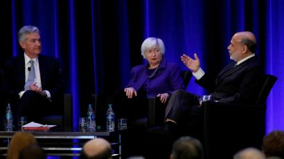 : U.S. Federal Reserve Chairman Jerome Powell and former Fed Chair Janet Yellen look on as former Fed Chairman Ben Bernanke speaks at the American Economic Association meetings