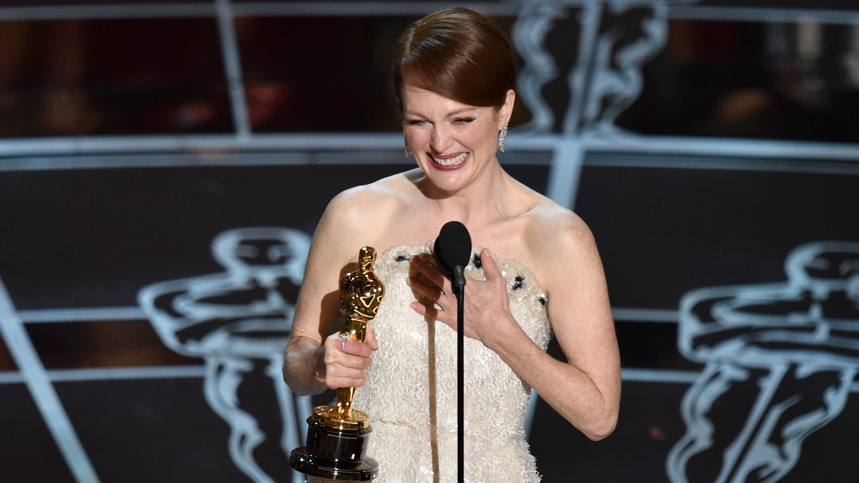 """Julianne Moore accepts the award for best actress in a leading role for """"Still Alice"""" at the Oscars on Sunday, Feb. 22, 2015, at the Dolby Theatre in Los Angeles. (Photo by John Shearer/Invision/AP)"""
