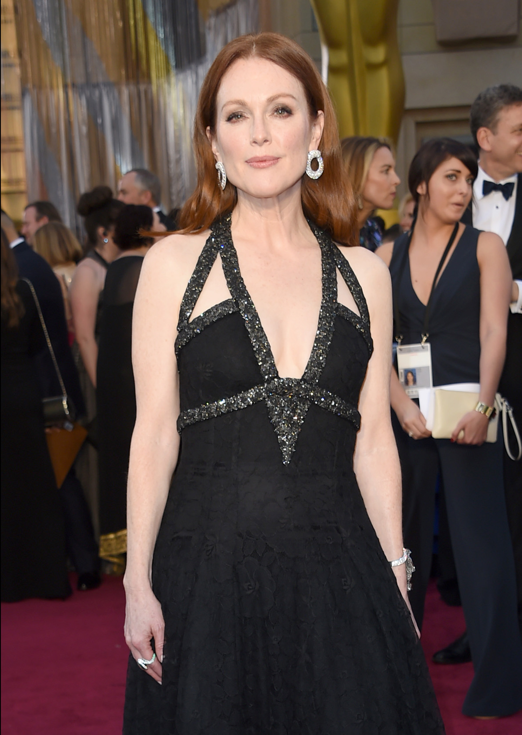 Julianne Moore arrives at the Oscars on Sunday, Feb. 28, 2016, at the Dolby Theatre in Los Angeles. (Photo by Richard Shotwell/Invision/AP)