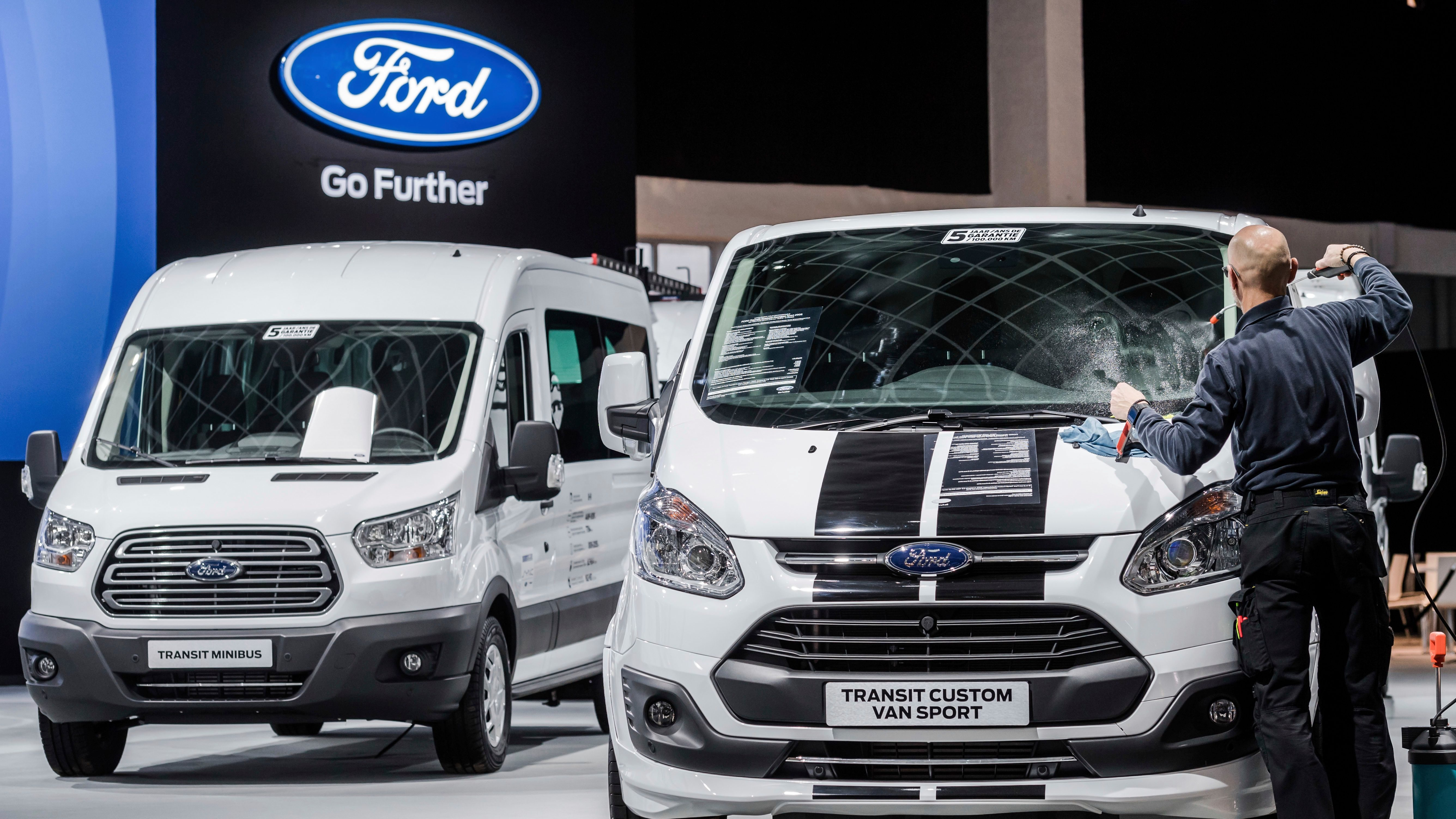 A Ford worker cleans a windowscreen of the Ford Transit Custom Van Sport