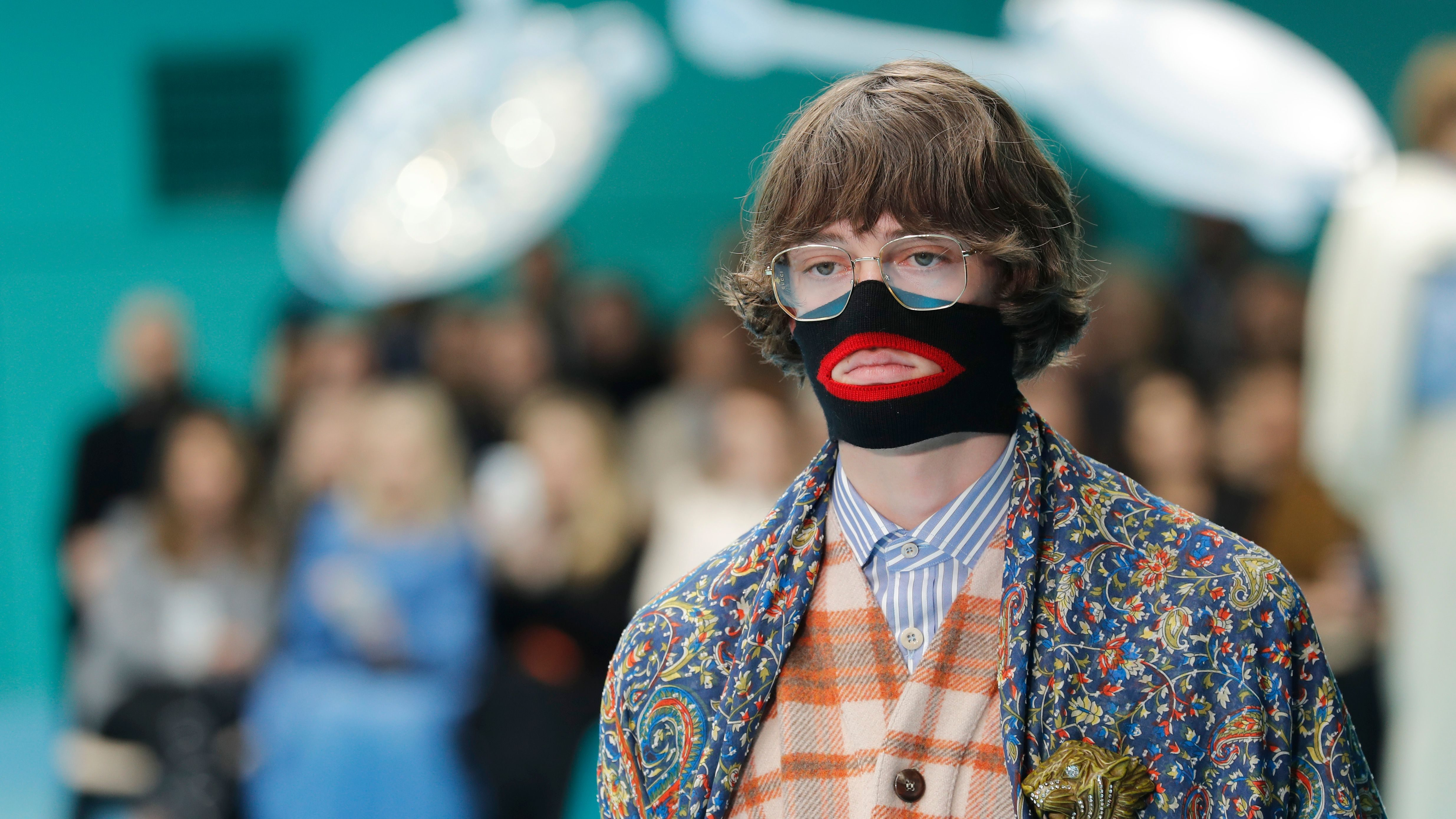 A model wears a creation as part of the Gucci women's Fall/Winter 2018-2019 collection, presented during the Milan Fashion Week, in Milan, Italy, Wednesday, Feb. 21, 2018. (AP Photo/Antonio Calanni)