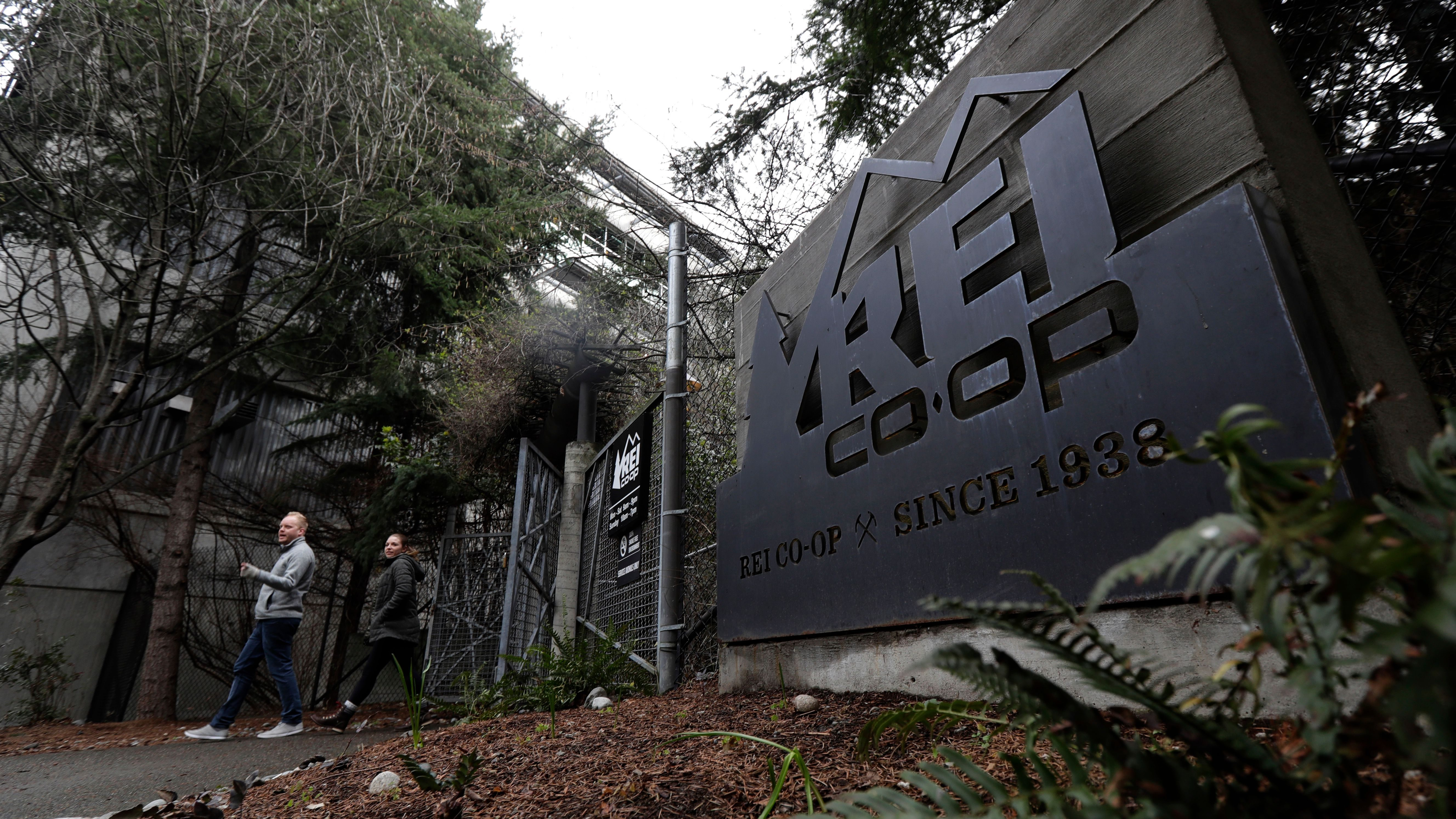 An entrance to the REI flagship store is shown Friday, March 2, 2018, in Seattle. (AP Photo/Ted S. Warren)