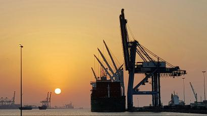 In this photo taken Tuesday, March 13, 2018 the sun sets in the port of Djibouti. The tiny Horn of Africa nation of Djibouti with less than 1 million inhabitants, has become a military outpost for China, France, Italy and Japan, with that nation's first overseas base since World War II.