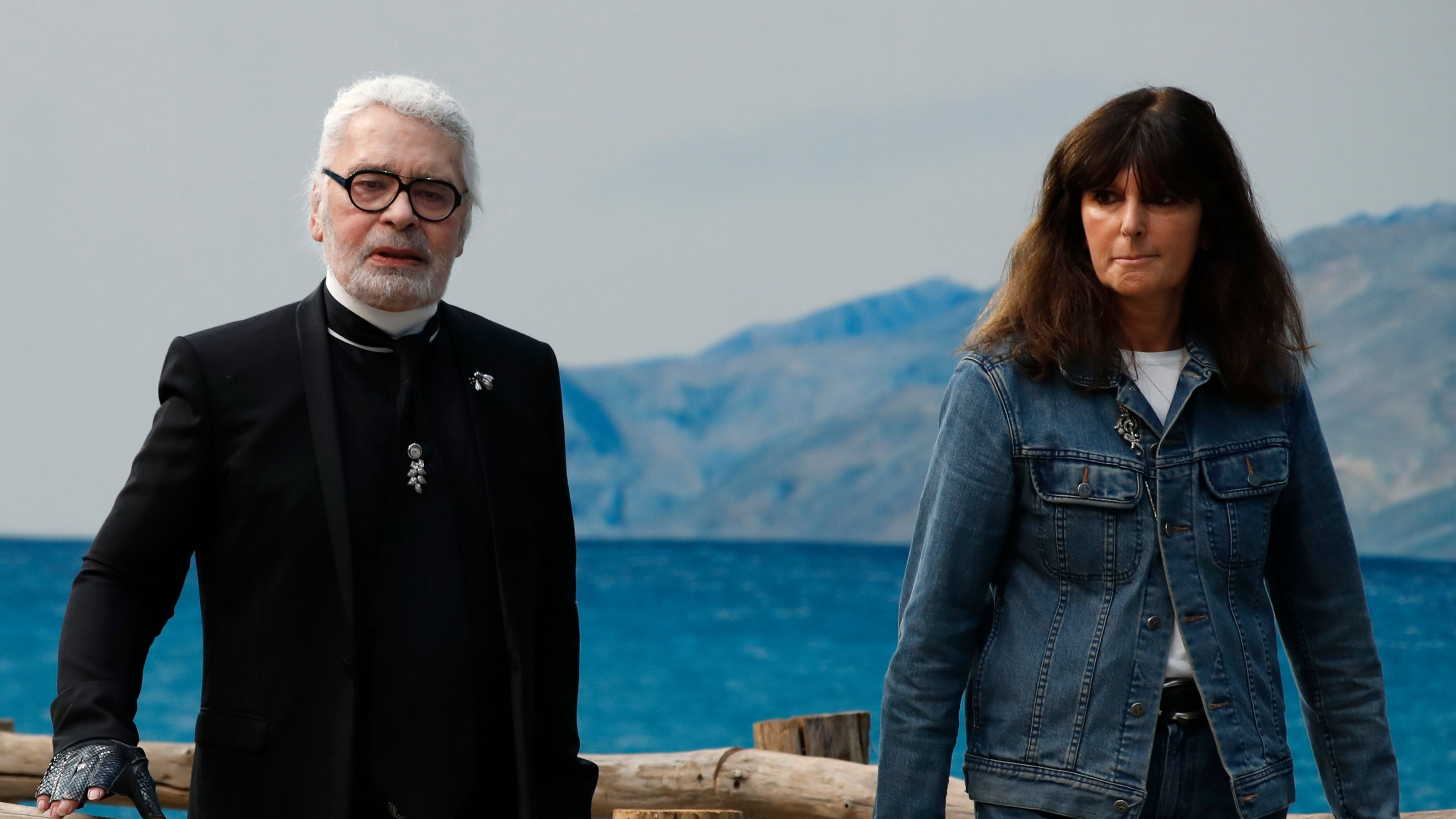 FILE - In this Oct.2, 2018 file photo, French fashion studio director Virginie Viard and German fashion designer Karl Lagerfeld pose after the presentation of Chanel Spring/Summer 2019 ready-to-wear fashion collection in Paris. Chanel said Tuesday, Feb.19, 2019 that Virginie Viard, his longtime head of studio, will create the house's upcoming collections after Lagerfelfd died. Chanel did not say whether her appointment was permanent. (AP Photo/Christophe Ena, File)