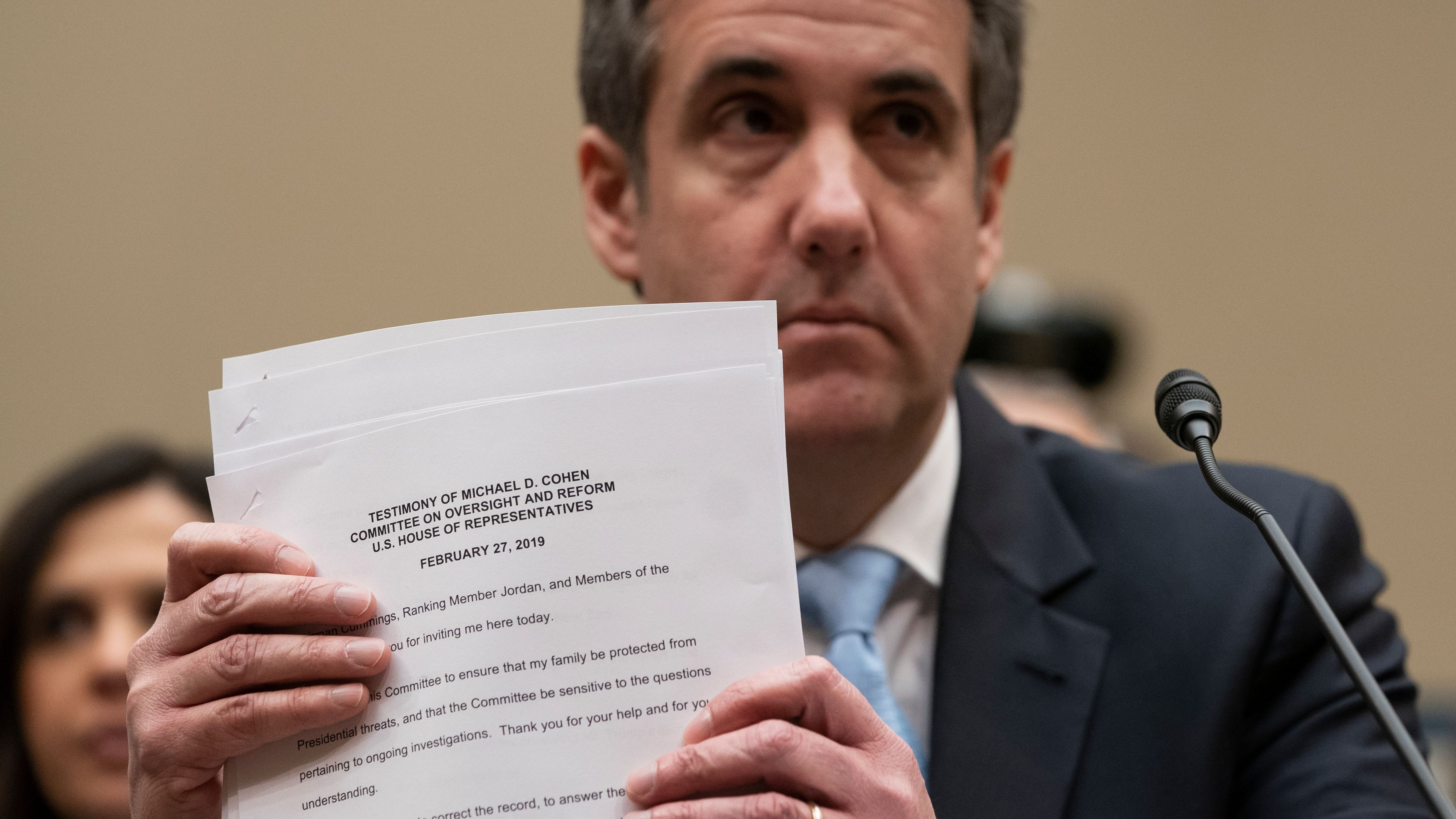 Michael Cohen, President Donald Trump's former personal lawyer, finishes reading his opening statement as he testifies before the House Oversight and Reform Committee on Capitol Hill in Washington