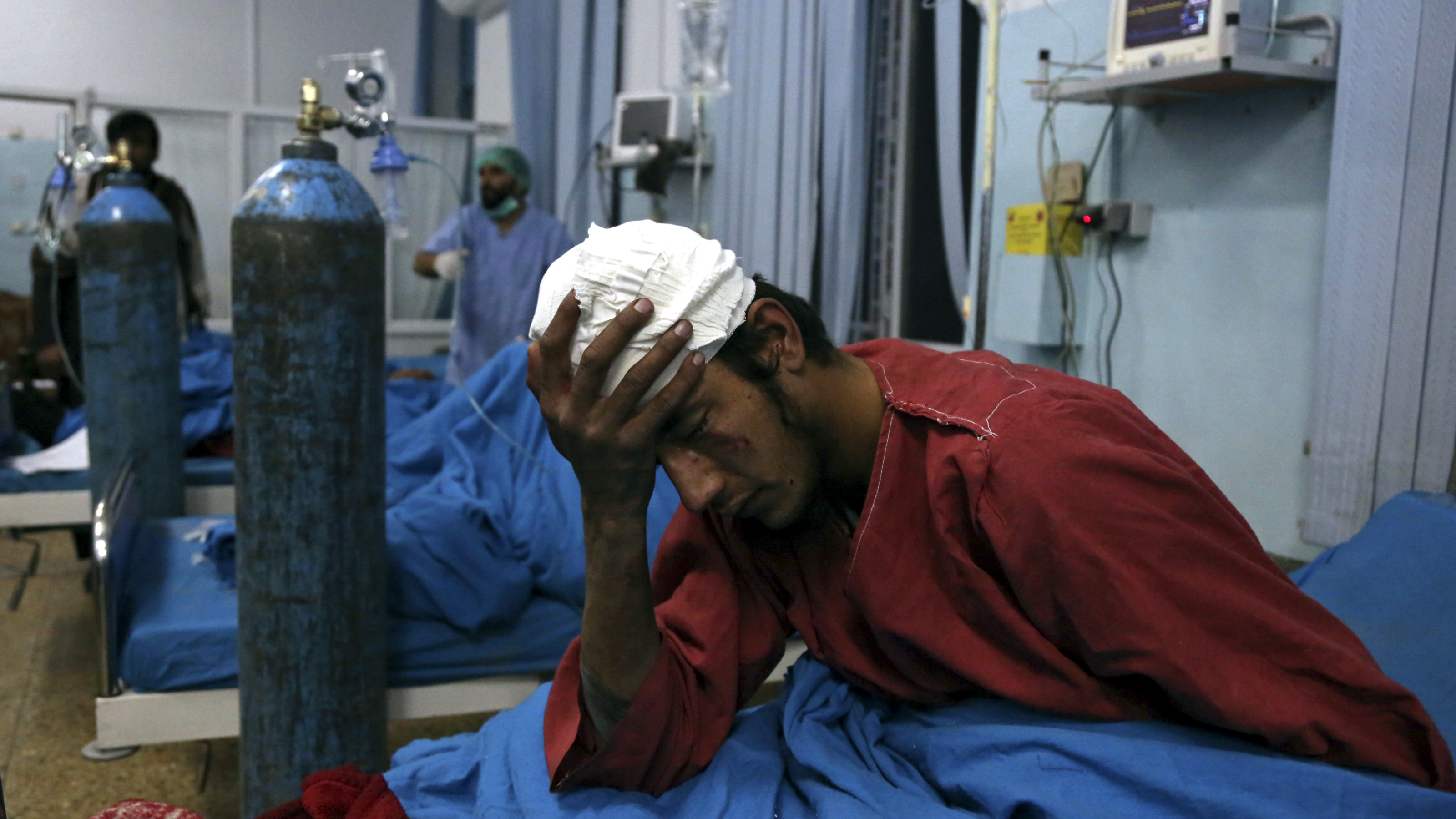 An injured man receives treatment at a hospital after a suicide bombing in Kabul, Afghanistan, Nov. 20, 2018. Afghan officials said the suicide bomber targeted a gathering of Muslim religious scholars in Kabul, killing tens of people. A Public Health Ministry spokesman said another 60 people were wounded in the attack, which took place as Muslims around the world marked the birthday of the Prophet Mohammad.