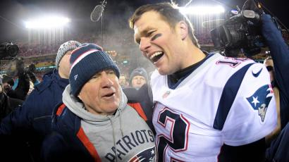 Jan 20, 2019; Kansas City, MO, USA; New England Patriots head coach Bill Belichick and quarterback Tom Brady (12) celebrate the win over the Kansas City Chiefs during overtime in the AFC Championship game at Arrowhead Stadium.