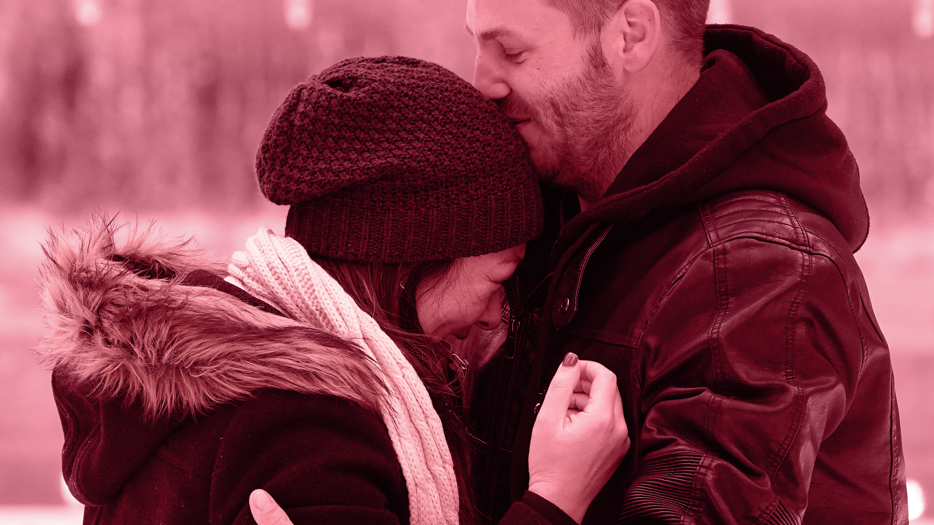 A man and woman hugging.