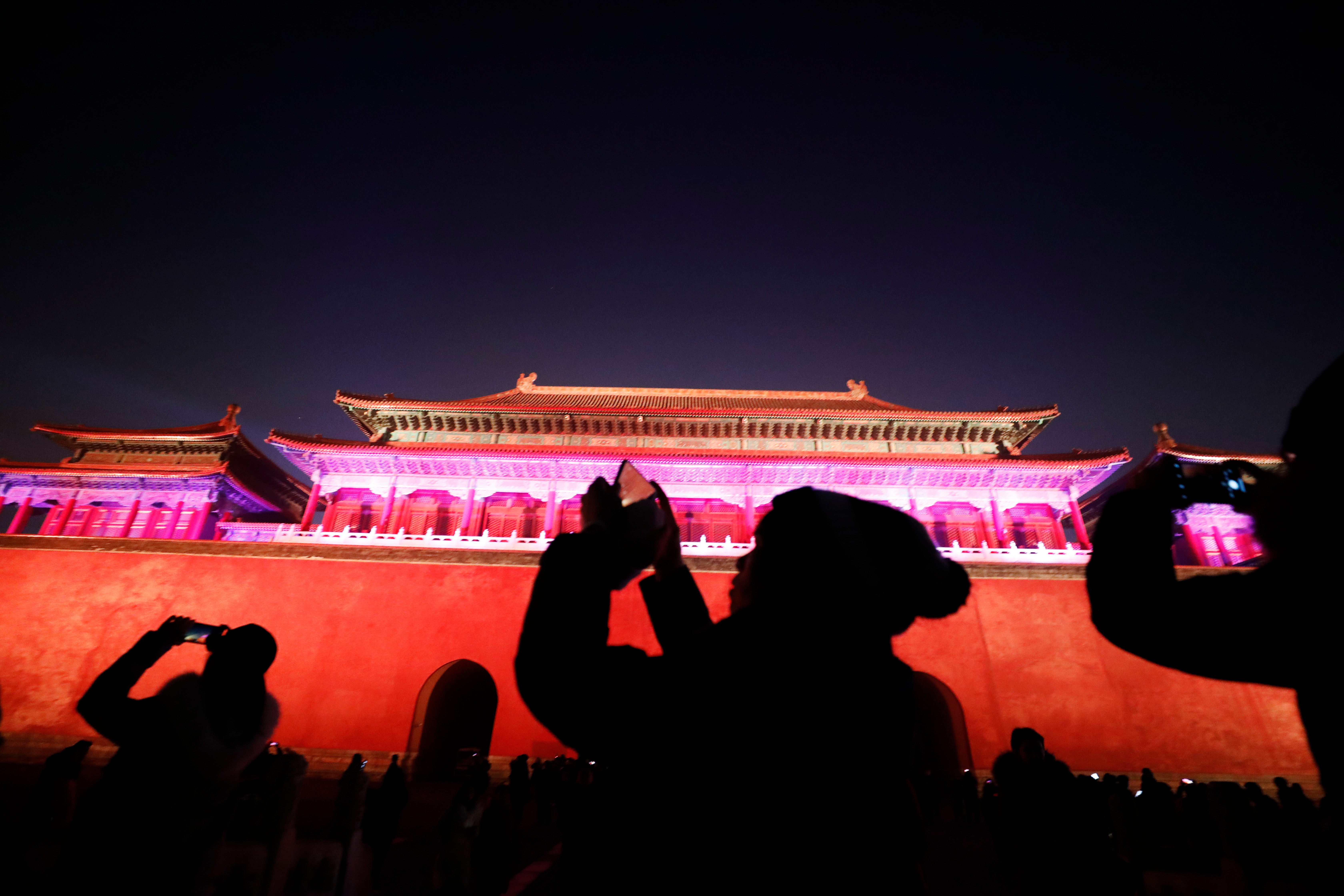 Visitors take pictures of the Forbidden City or Palace Museum lit up as part of celebrations for the Lantern Festival, marking the last day of the Chinese Lunar New Year in Beijing, China, 19 February 2019. For the first time in 94 years, Beijing's Forbidden City is lit up at night and opened to the public to celebrate the Lantern Festival as part of the lunar new year celebrations. Forbidden City or Palace Museum lights up for Lantern Festival, Beijing, China - 19 Feb 2019