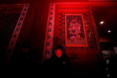 A security officer stand guard in the Forbidden City or Palace Museum lit up as part of celebrations for the Lantern Festival, marking the last day of the Chinese Lunar New Year in Beijing, China, 19 February 2019. For the first time in 94 years, Beijing's Forbidden City is lit up at night and opened to the public to celebrate the Lantern Festival as part of the lunar new year celebrations. Forbidden City or Palace Museum lights up for Lantern Festival, Beijing, China - 19 Feb 2019