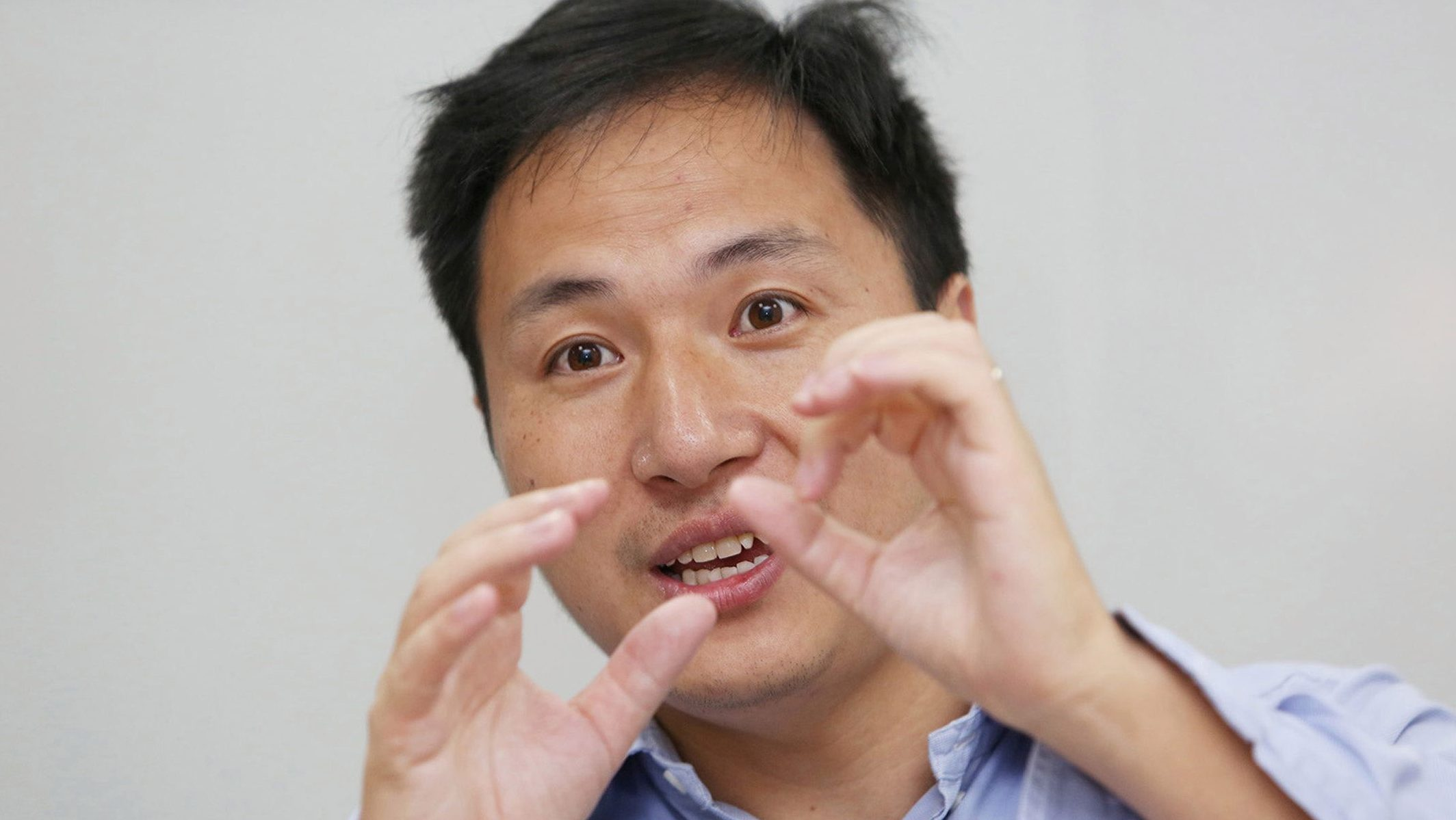 Scientist He Jiankui speaks at his company Direct Genomics in Shenzhen, Guangdong province, China July 18, 2017. Picture taken July 18, 2017. REUTERS/Stringer ATTENTION EDITORS - THIS IMAGE WAS PROVIDED BY A THIRD PARTY. CHINA OUT. - RC1F93F0D840