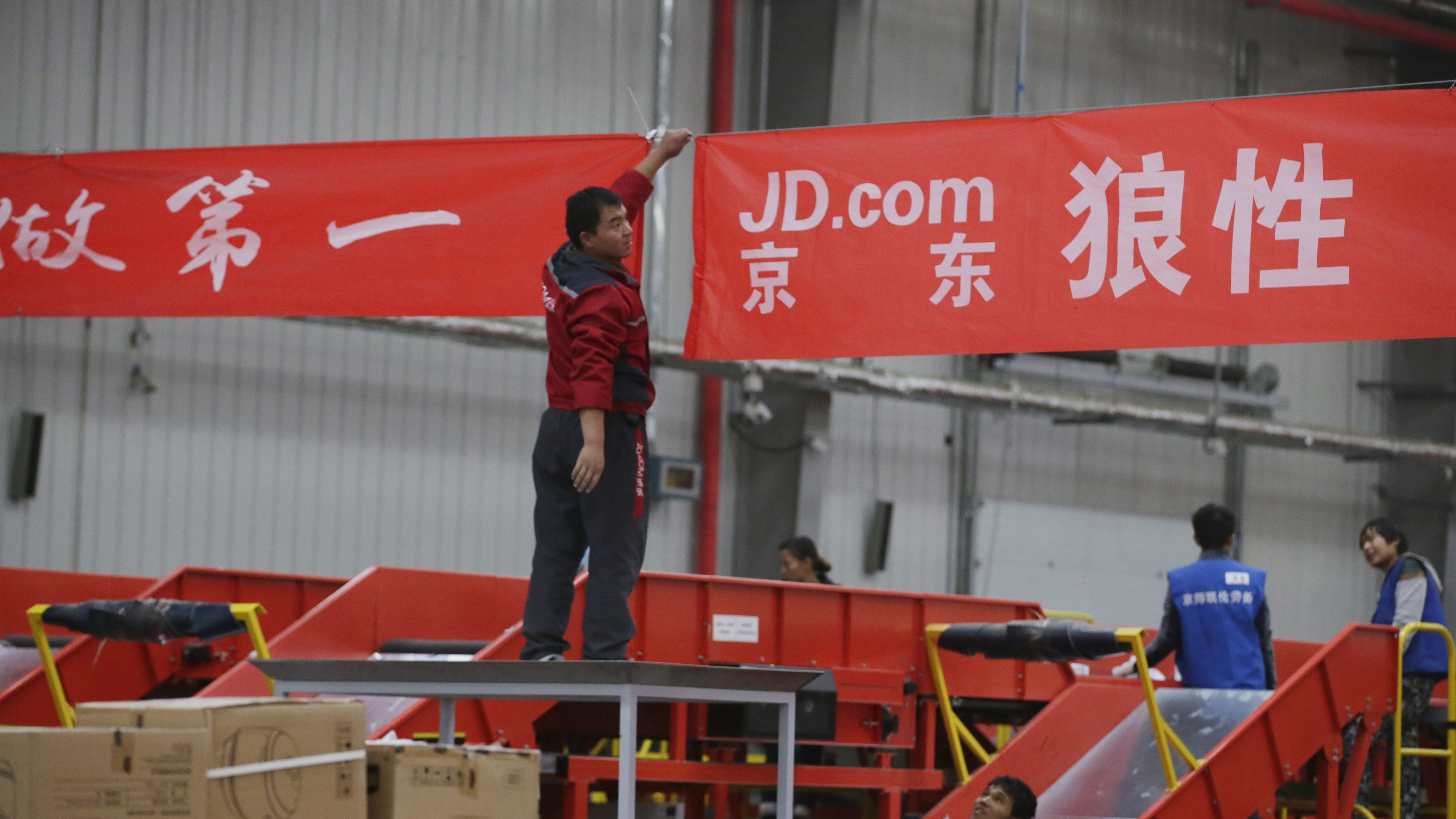 An employee works at a JD.com logistic centre in Langfang, Hebei province, November 10, 2015. On China's giant Singles Day internet shopping festival, the country's delivery firms are stretched so thin that they are looking for tie-ups, listings and new investors to husband their resources. E-commerce has been a huge boon to the logistics industry, but the ever-bigger Singles Day, run by leading online market company Alibaba Group Holding Ltd on Nov. 11 every year, exacerbates the industry's twin dilemmas of cut-throat competition and rising labor costs. With low barriers to entry, express couriers proliferated rapidly over the past decade to more than 8,000 firms, squeezing profit margins to about 5 percent, down from 30 percent 10 years ago, according to analysts.