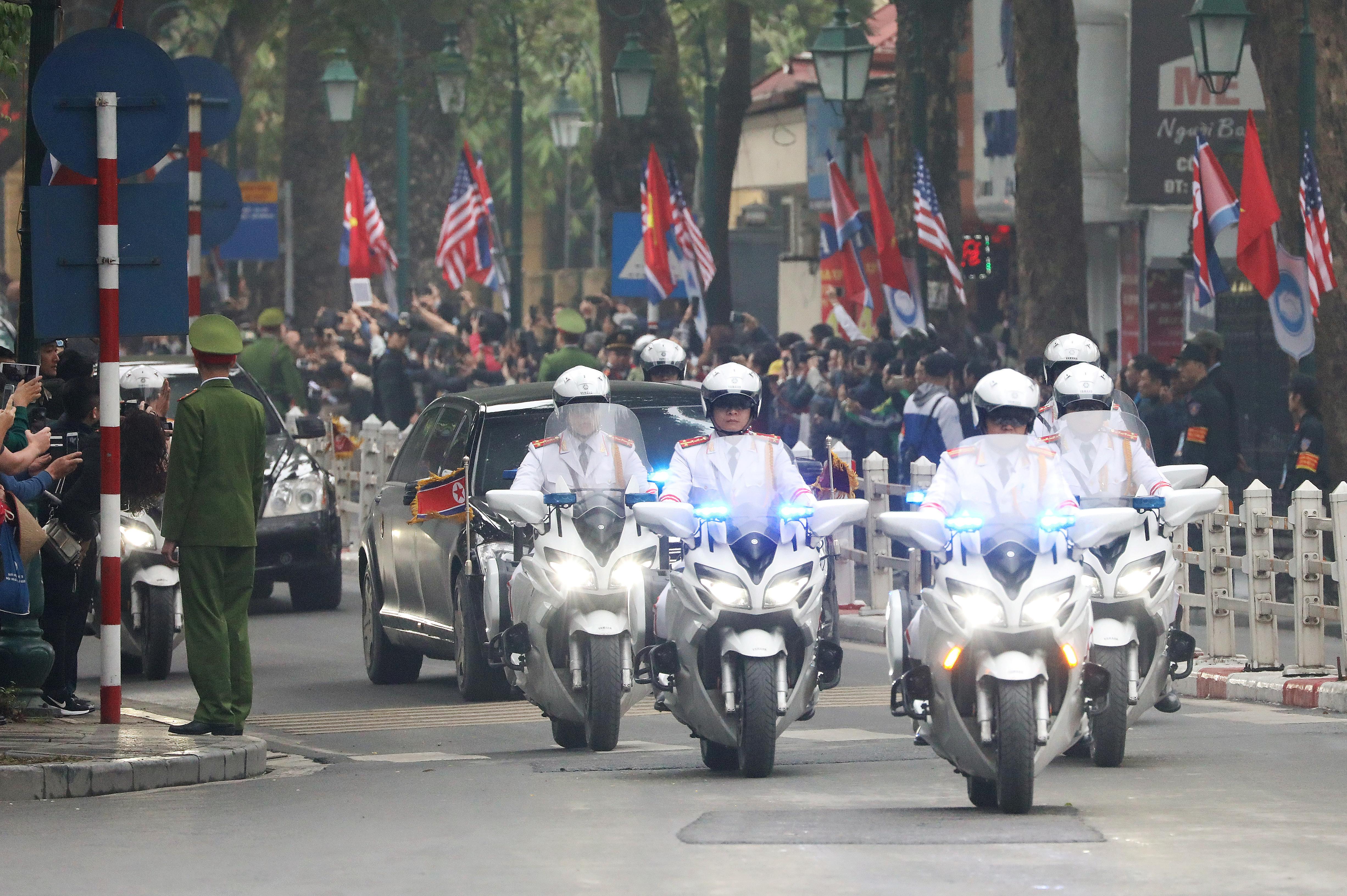 The motorcade of North Korean leader Kim Jong Un is seen passing the Opera House, ahead of a second summit with U.S. President Donald Trump, in Hanoi, Vietnam February 26, 2019. REUTERS/Ann Wang - RC1CDBBCCDA0