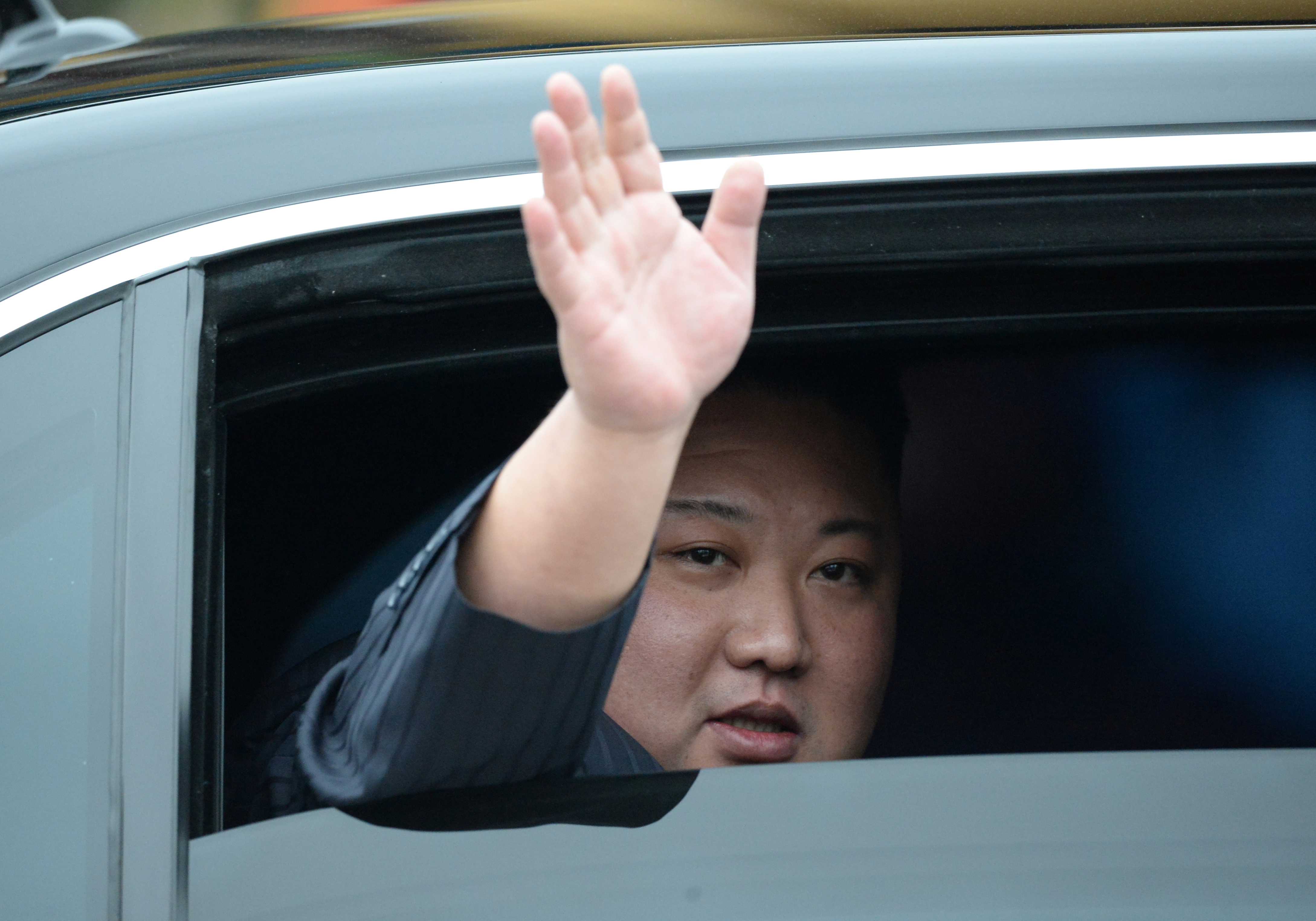 North Korea's leader Kim Jong Un waves upon his arrival at the border town with China in Dong Dang, Vietnam, February 26, 2019. REUTERS/Stringer NO RESALES. NO ARCHIVES - RC1DE9DF3E20
