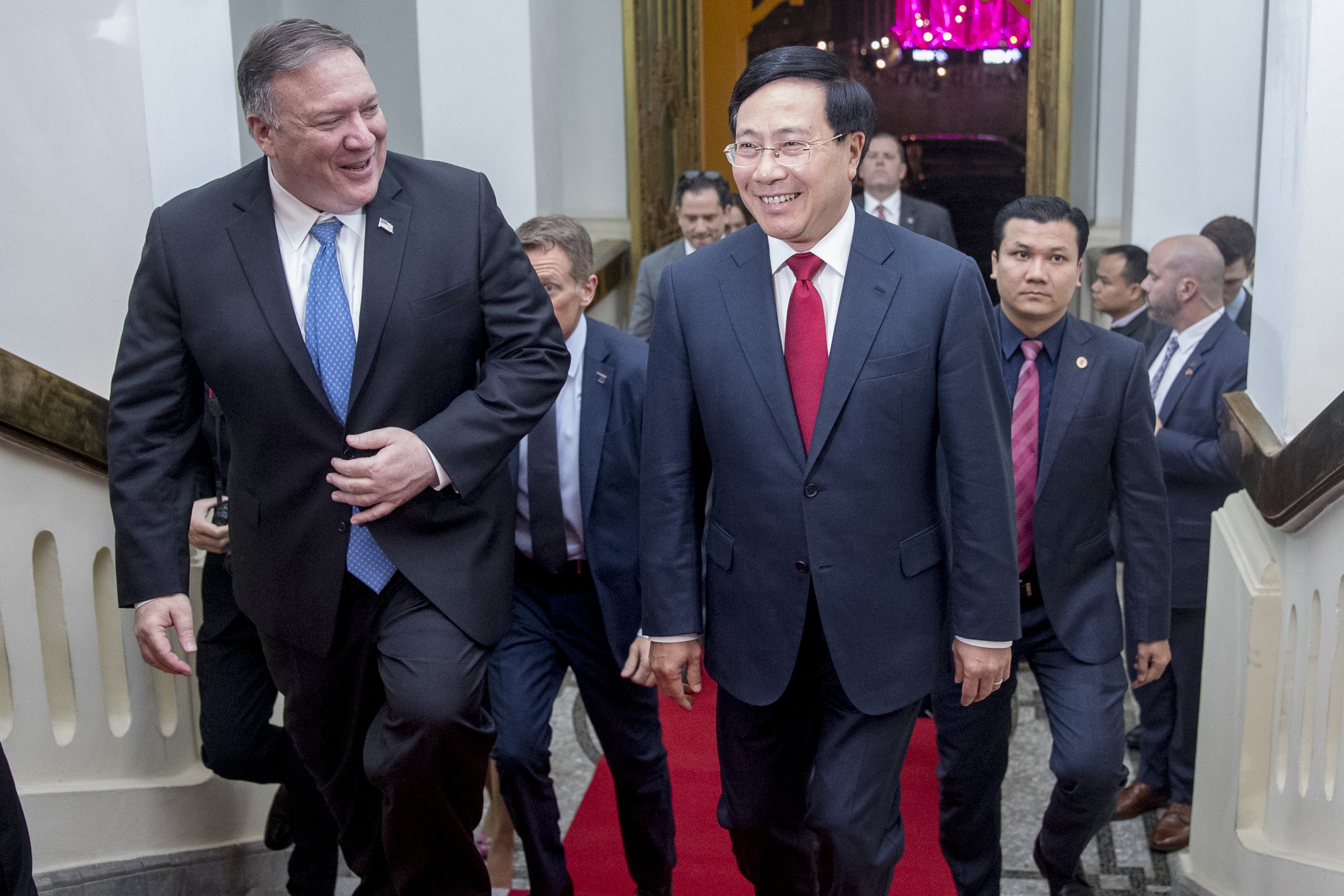 Secretary of State Mike Pompeo and Vietnamese Deputy Prime Minister and Foreign Minister Pham Binh Minh arrive for a meeting at the Ministry of Foreign Affairs in Hanoi, Vietnam, Tuesday, Feb. 26, 2019. Pompeo is in Vietnam for a second summit between President Donald Trump and North Korean leader Kim Jong Un. (AP Photo/Andrew Harnik, Pool)