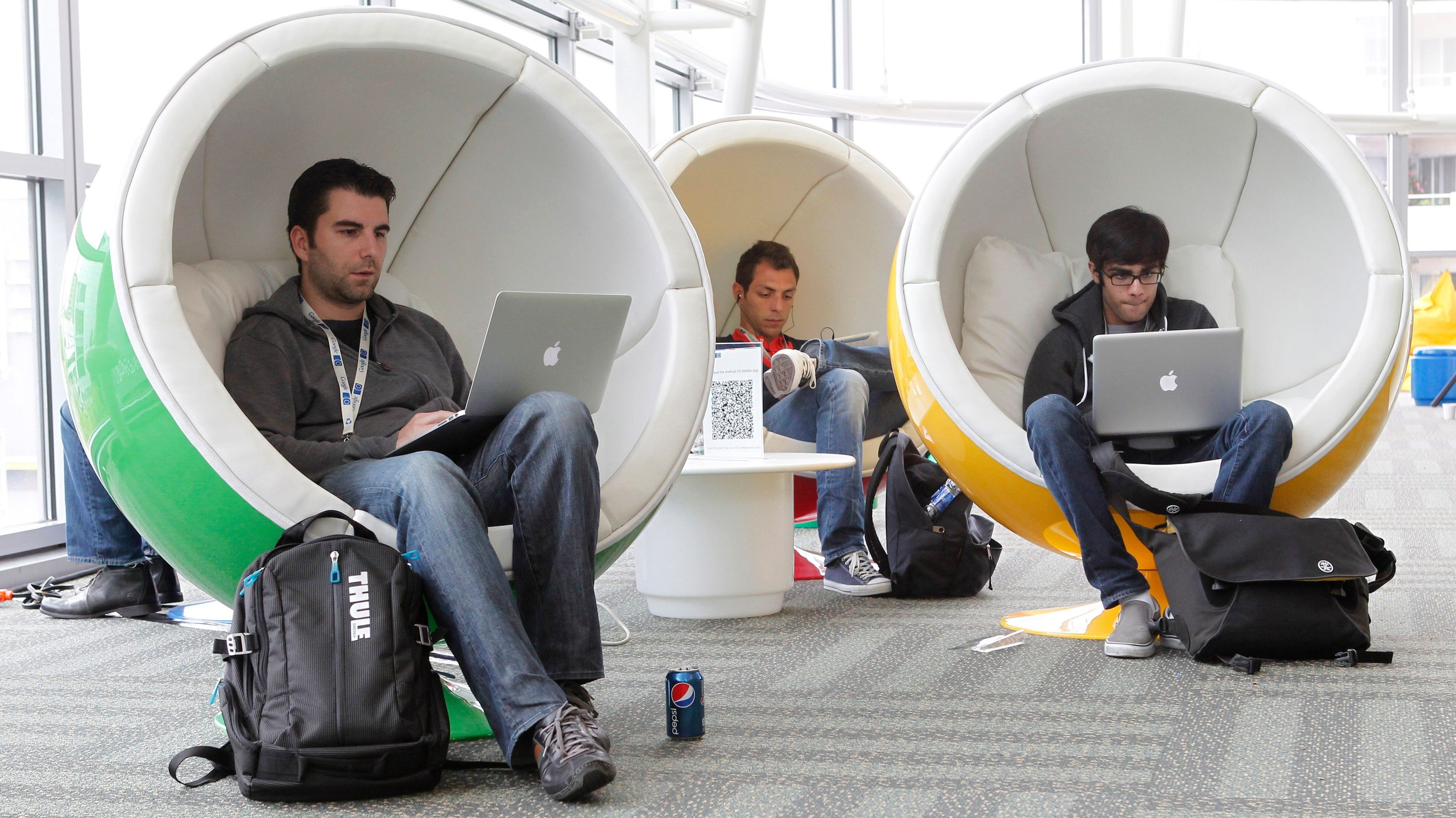 Matthias Klabbenbach (L), of eBay, Massimo Paladin (2nd L), of Cern, and Shahruz Shaukat, of University of California at Davis, take a break between events at the Google I/O Developers Conference in the Moscone Center in San Francisco.