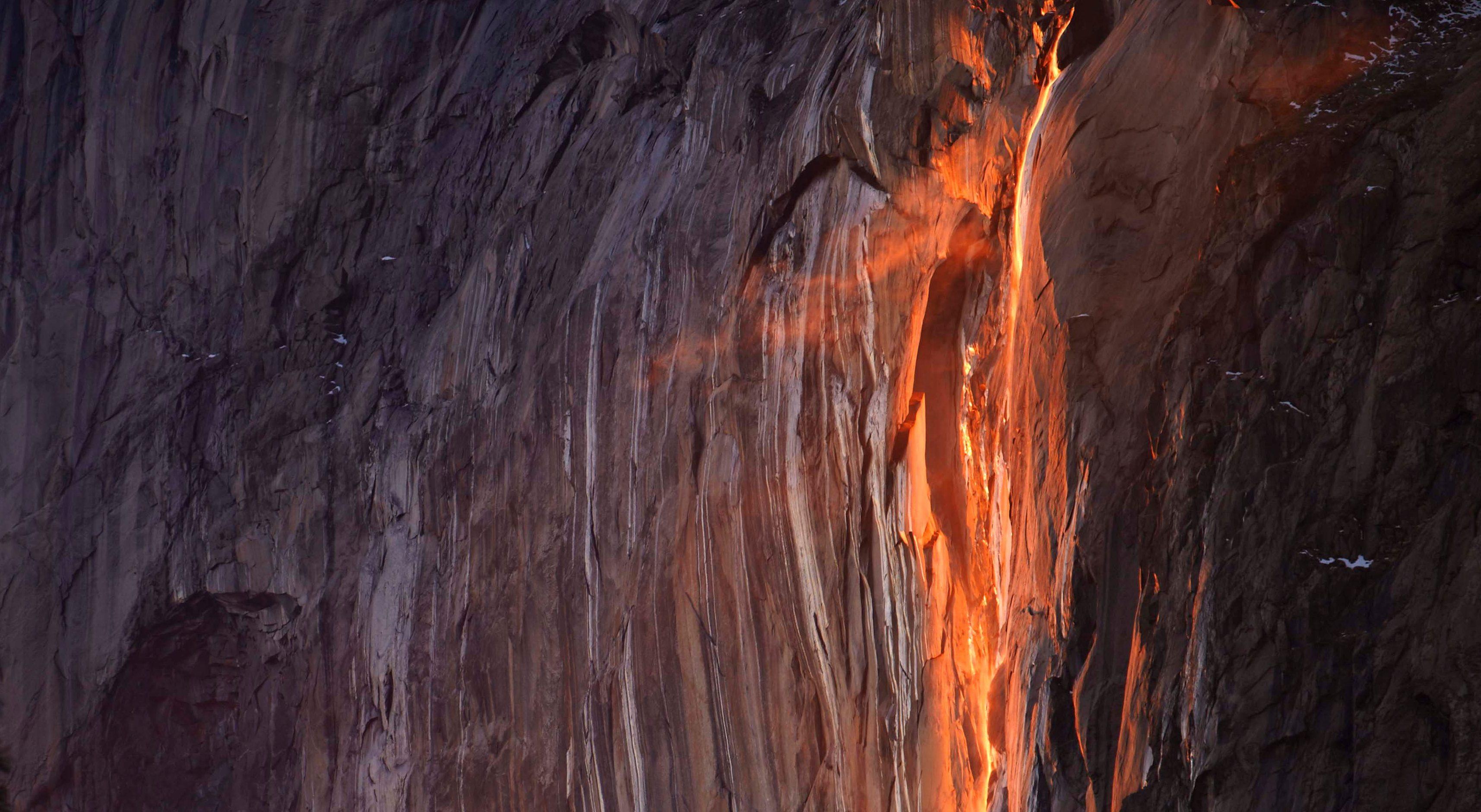 "Viral photos show Yosemite's ""firefall"" phenomenon glowing in California"