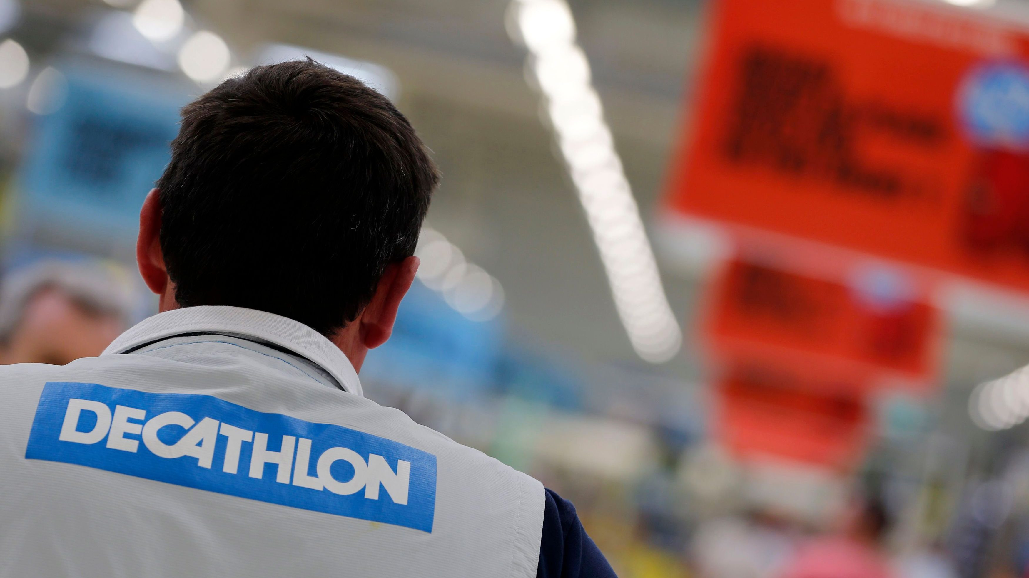 An employee works at the French sports equipment and sportswear company Decathlon store in Merignac near Bordeaux July 10, 2014. The group, number one in French distribution of sports equipment, with 730 stores worldwide, of which 262 are in France, focuses on the variety of its in-house brands to accelerate its growth and its expansion plans. Picture taken July 10, 2014. REUTERS/Regis Duvignau (FRANCE - Tags: BUSINESS) - PM1EA7B0S7T01