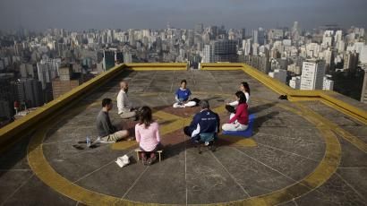 "People meditate on the helipad of Copan building to celebrate ""World Health Day"" in downtown Sao Paulo"