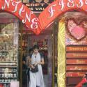 A VALENTINE'S DAY HEART FRAMES THE ENTRANCE TO A SHOP IN BOMBAY.