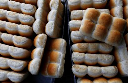 Baked buns are seen seen in trays at a bakery in Mumbai