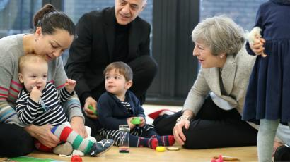 Britain's Prime Minister Theresa May joins a parent and baby group