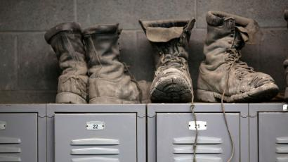 Coal mining boots are shown above miners' lockers