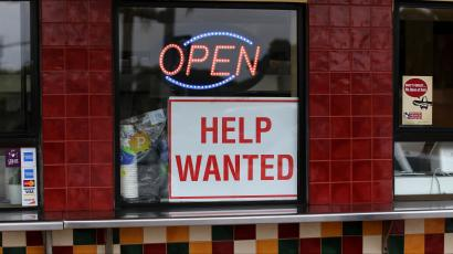 A help wanted sign at a store in California