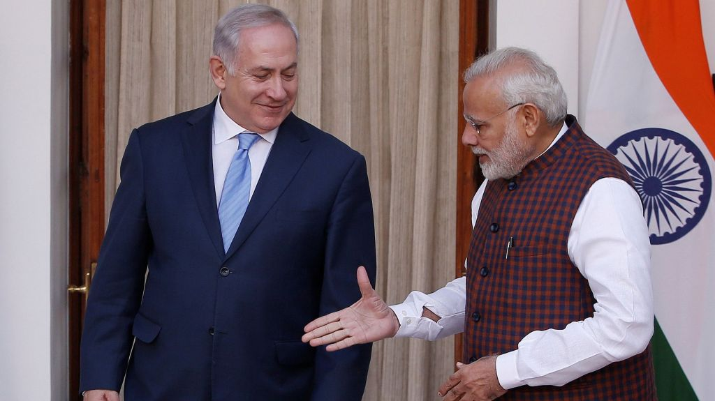 India's Prime Minister Modi extends his hand for a handshake with his Israeli counterpart Netanyahu during a photo opportunity ahead of their meeting at Hyderabad House in New Delhi