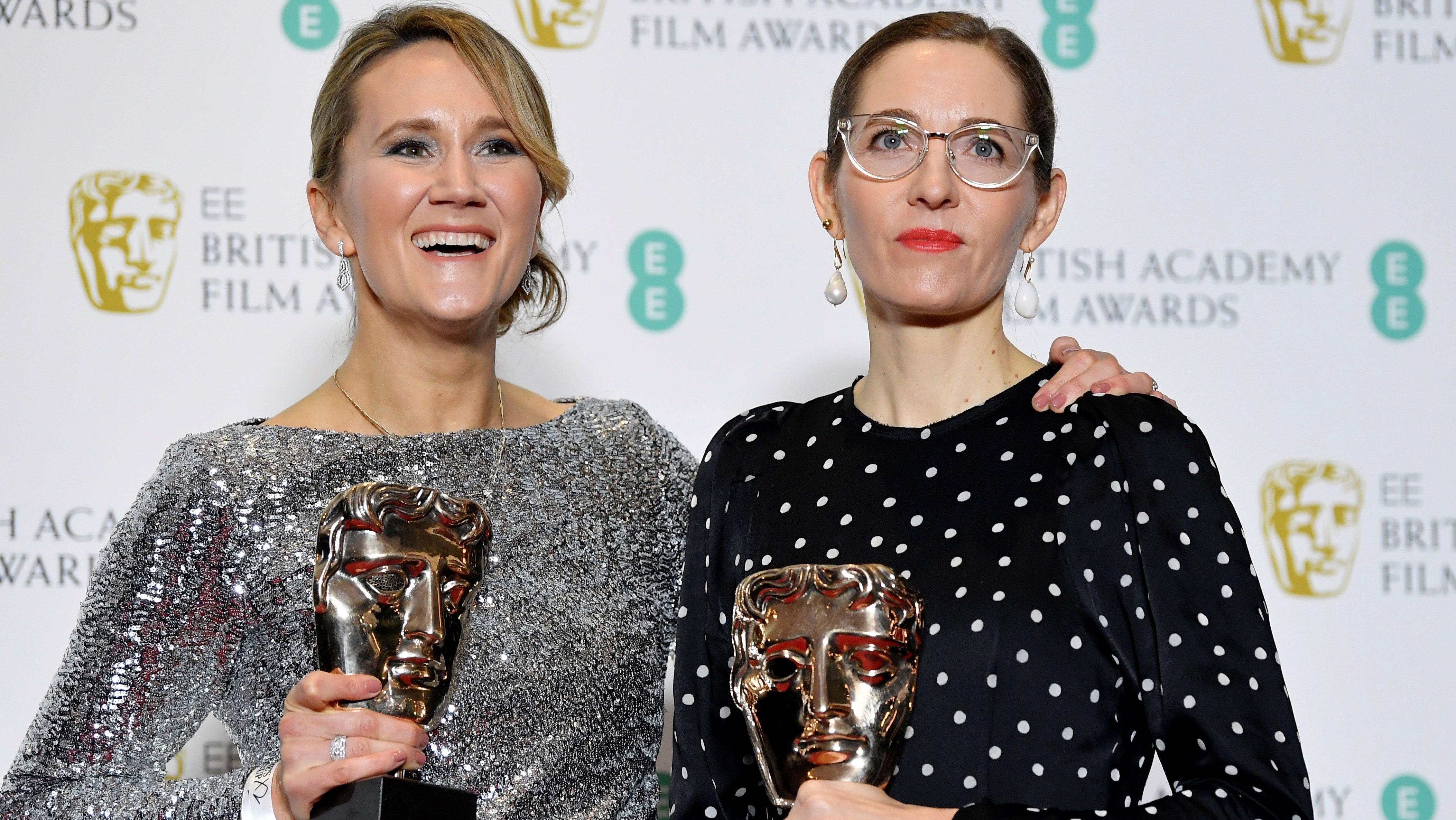 Alice Felton and Fiona Crombie hold their awards for Production Design for 'The Favourite' at the British Academy of Film and Television Awards (BAFTA)