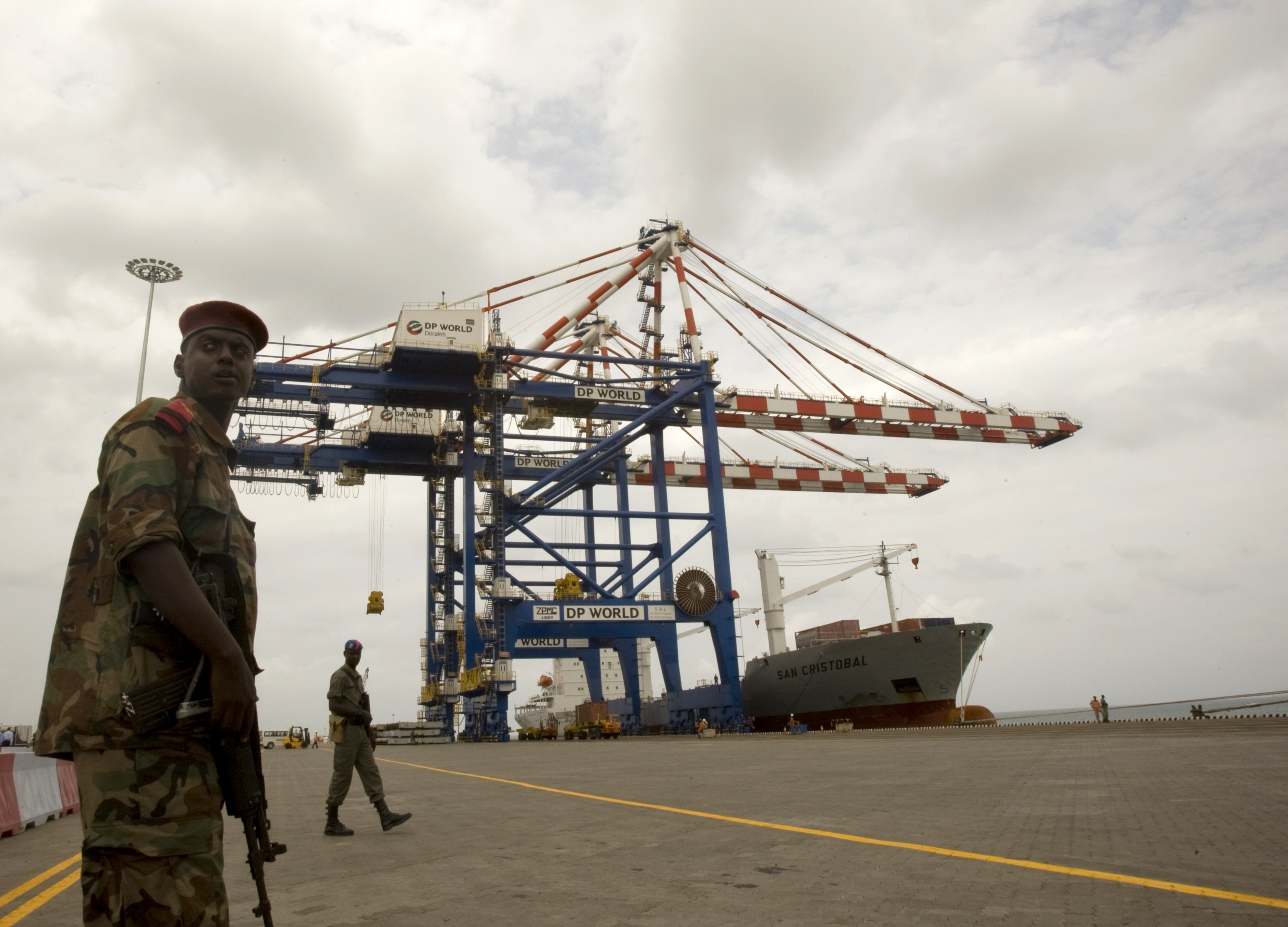 A Djibouti policeman stands guard during the opening ceremony of Dubai-based port operator DP World's Doraleh container terminal in Djibouti port February 7, 2009.