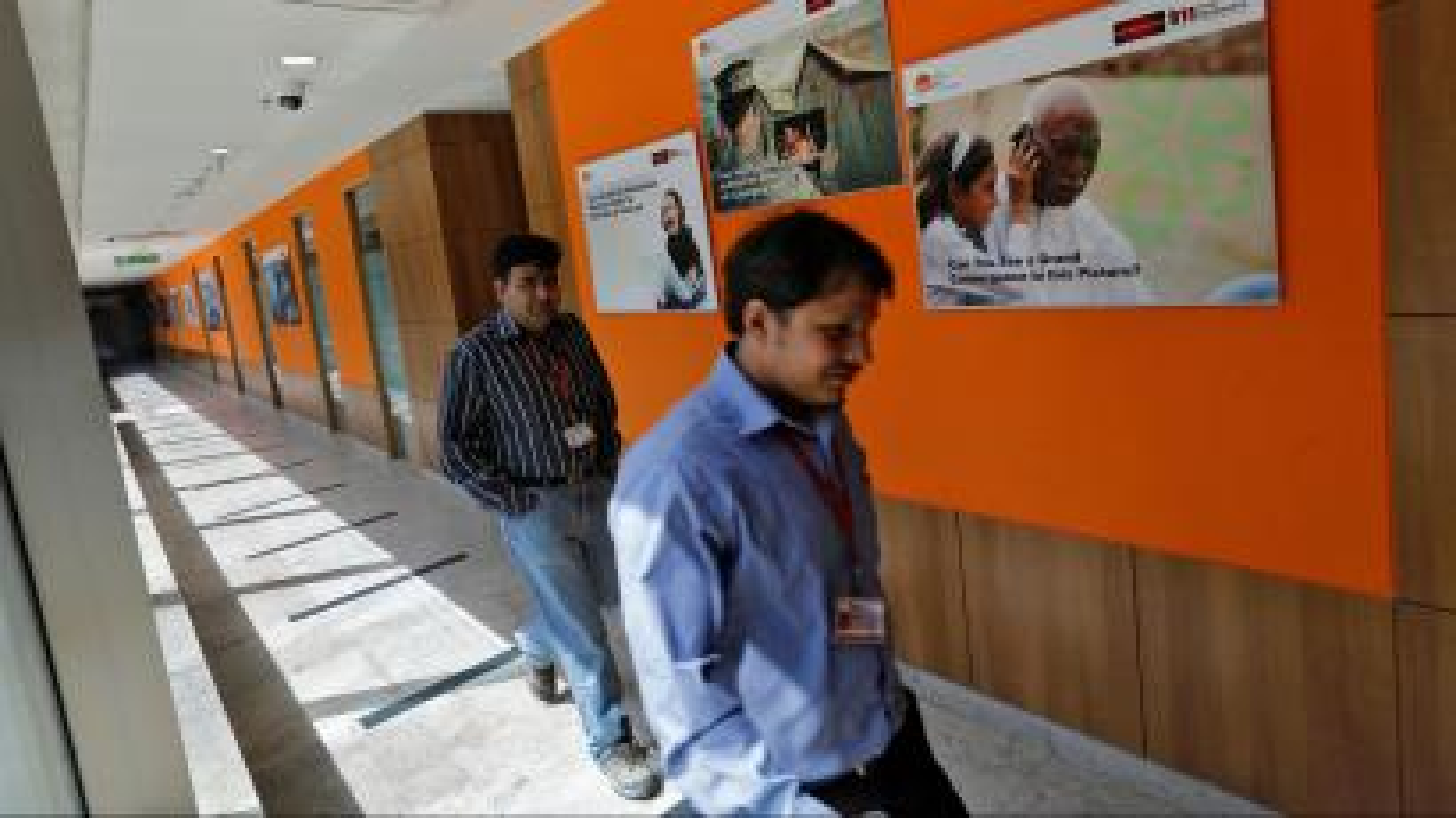 Employees walk inside Tech Mahindra office building in Noida