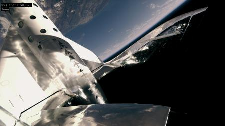 A view from the spaceplane's tail boom as it begins its return to earth.