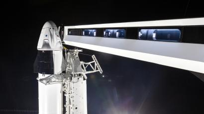 A photo of the bridge from the launch tower to the crew Dragon space capsule on top of the Falcon 9 rocket.