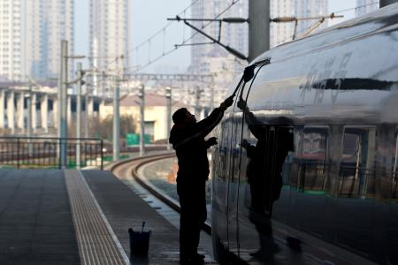 In this Tuesday Feb. 28, 2012 photo, a worker cleans exterior of a CRH high-speed train at Tianjin Railway Station in Tianjin, China. A section of a high-speed railway line that had already undergone test runs has collapsed in central China following heavy rains, the latest accident since a crash last summer that killed 40 people, state media reported Monday March 12, 2012. (AP Photo/Alexander F. Yuan)