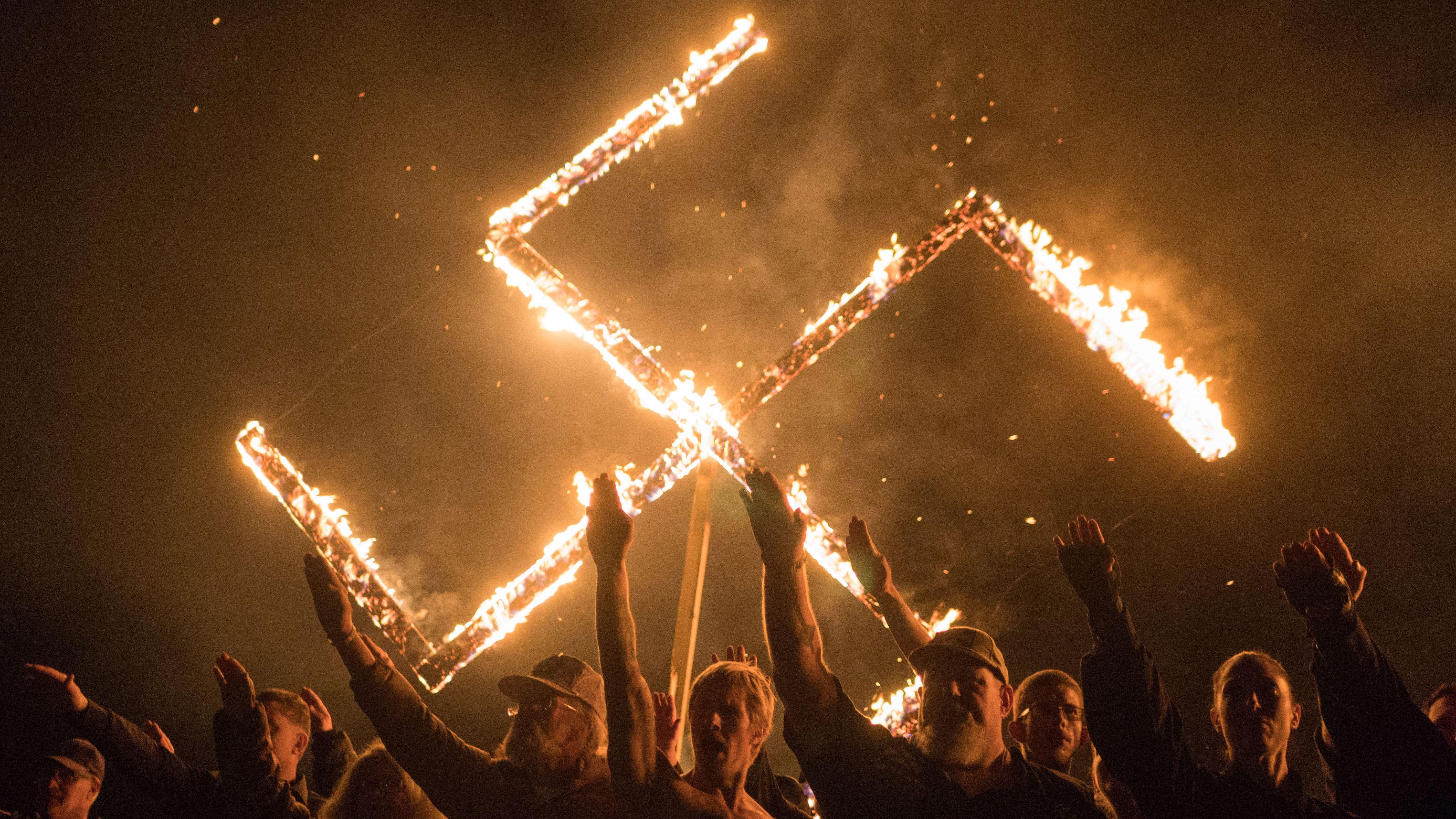 https://cms.qz.com/wp-content/uploads/2019/02/burning-swastika-e1550149715590.jpg?quality=75&strip=all&w=410&h=230.74217376011256