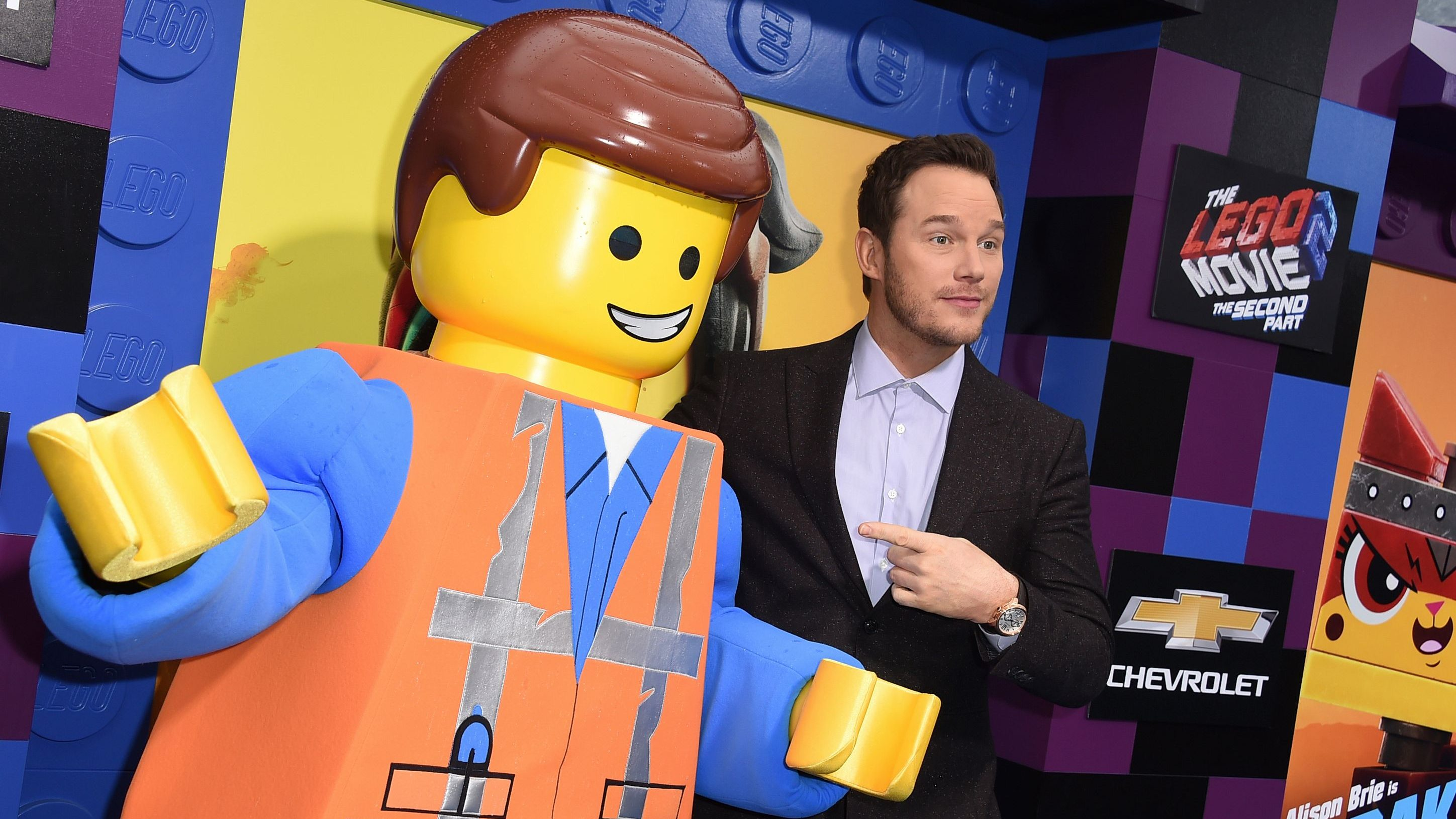 "Cast member Chris Pratt poses with his character at the world premiere of ""The Lego Movie 2: The Second Part"" on Sunday, Feb. 2, 2019, in Los Angeles."