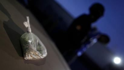 A bag of marijuana is on display as suspects are presented to the media after their arrest in Monterrey December 30, 2011. The two suspects were arrested after police found a small bag with marijuana valued at approximately 500 pesos ($36) in their car during a routine check, according to local media. REUTERS/Daniel Becerril (MEXICO - Tags: CRIME LAW DRUGS SOCIETY) - GM1E7CV15O601