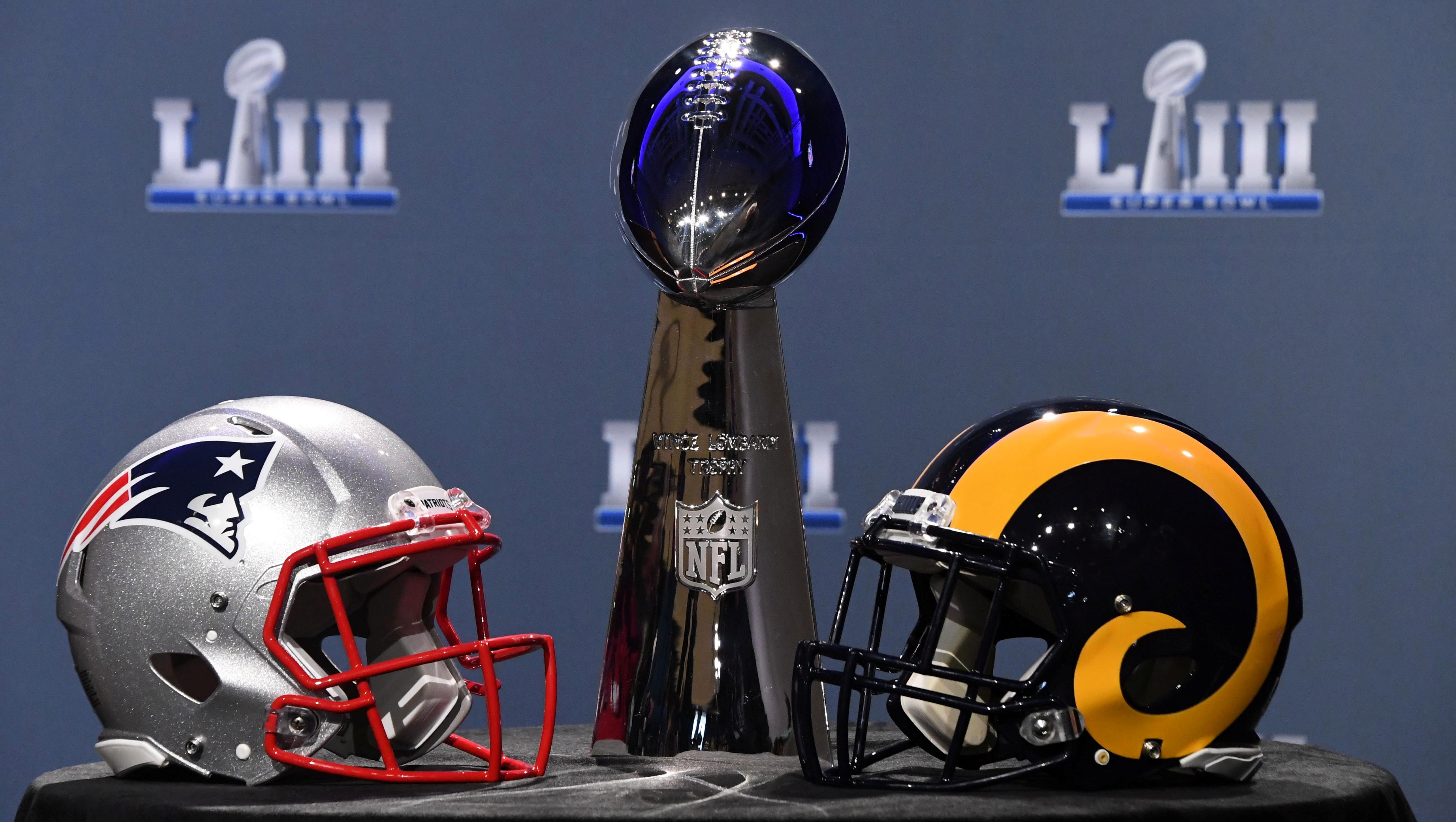 Jan 30, 2019; Atlanta, GA, USA; The Vince Lombardi Trophy and helmets for the New England Patriots and Los Angeles Rams are displayed before the Roger Goodell press conference in advance of Super Bowl LIII at Georgia World Congress Center.