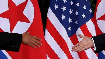 U.S. President Donald Trump and North Korea's leader Kim Jong Un meet at the start of their summit at the Capella Hotel on the resort island of Sentosa, Singapore June 12, 2018. Picture taken June 12, 2018.