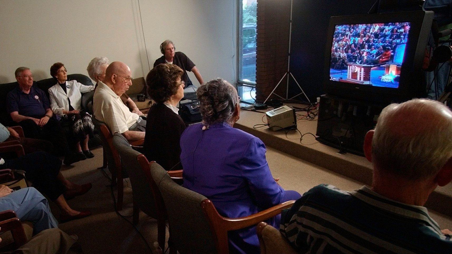 Elderly people in Arkansas watching TV