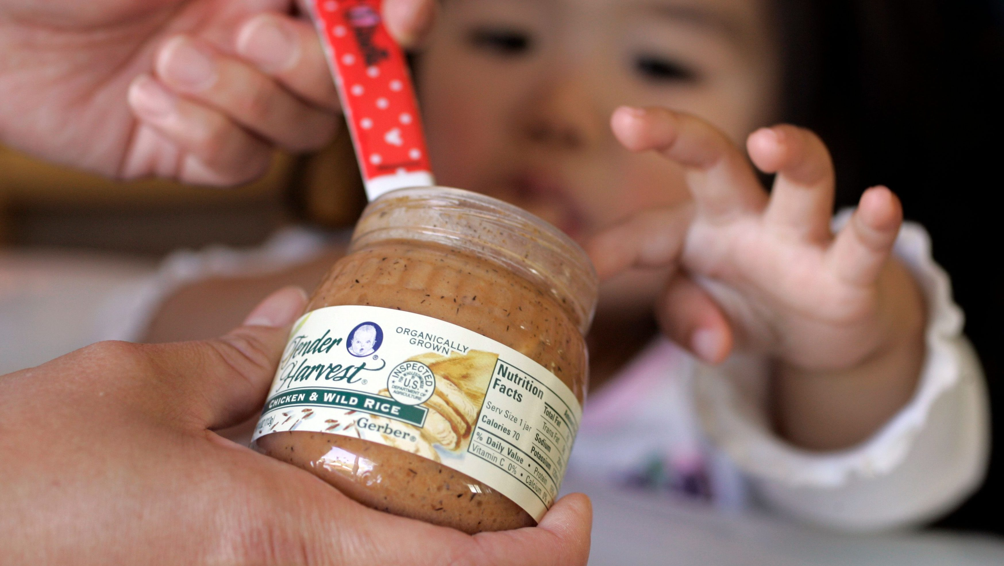 One-year-old Rachel Ho is feed Gerber baby food in Palo Alto, Calif., Thursday, April 12, 2007.